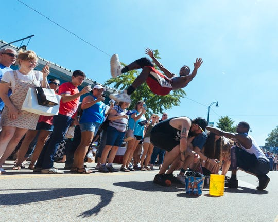 Beale Street Flippers perform tricks to a crowd of festival goers at the 2018 Cooper-Young Festival