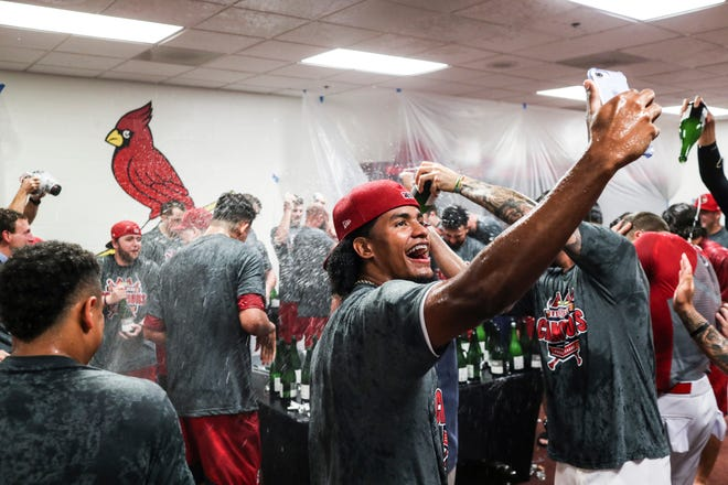 September 15 2018 - The Redbirds players celebrate in their clubhouse after winning Saturday's Pacific Coast League Championship game against the Fresno Grizzlies at AutoZone Park.