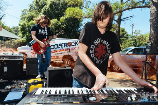 Students of the School of Rock perform for festival goers at the 2018 Cooper-Young Festival