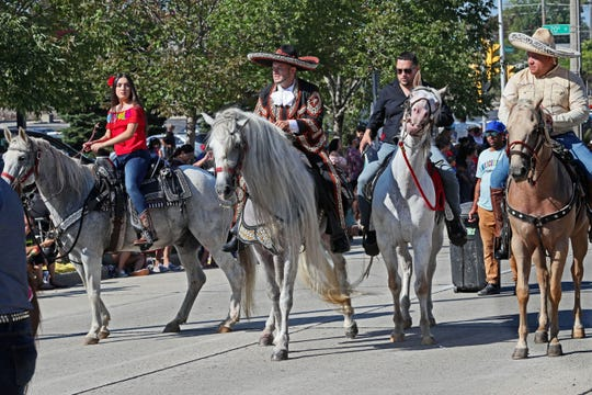 Riders on horseback, part of a float recalling the fight for Mexican independence, take part in the Mexican Independence Parade in 2018. The 2019 parade and festival is Sunday.