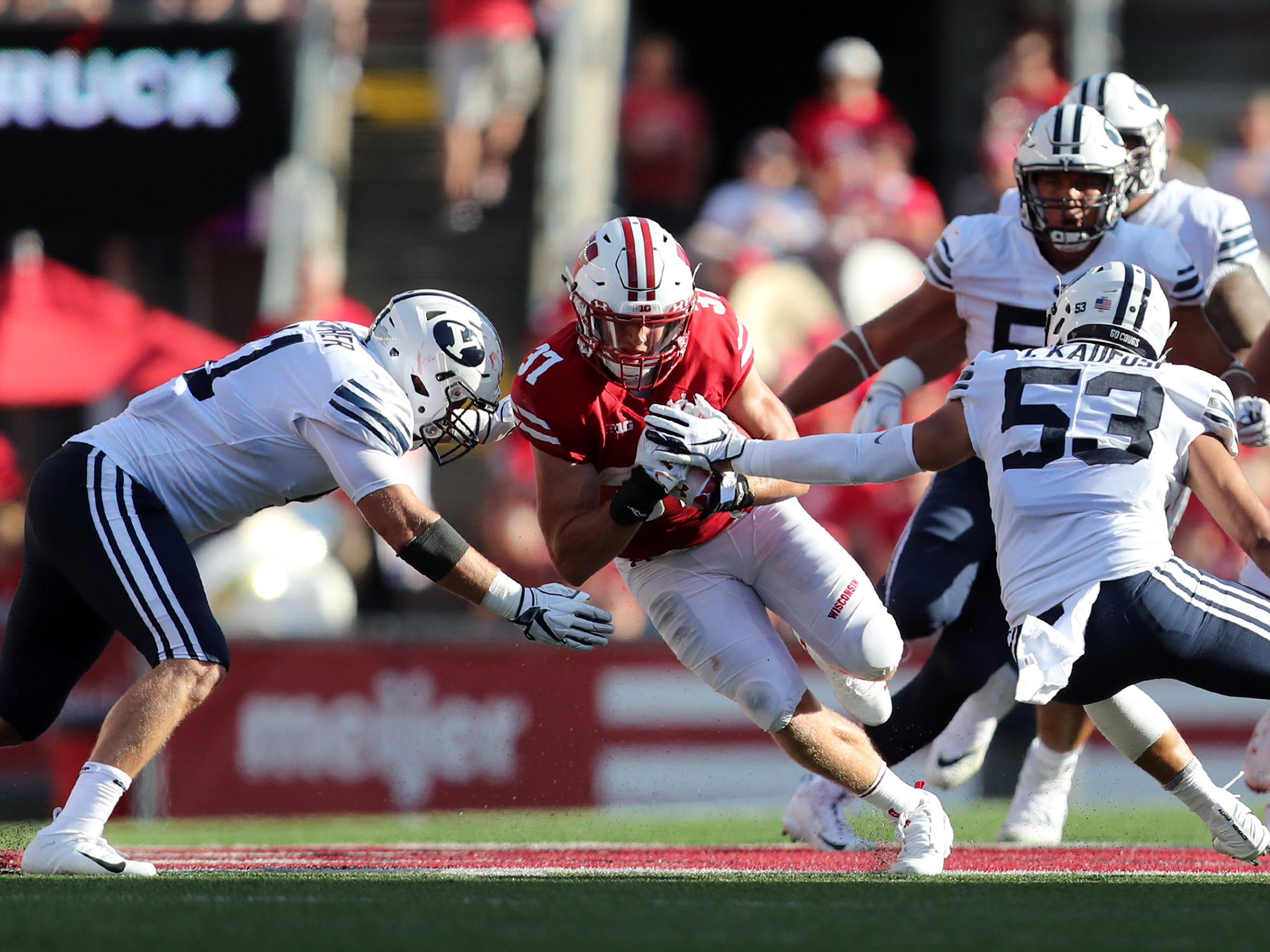 Wisconsin Badgers running back Garrett Groshek (37) tries to break through the Brigham Young defense Saturday at Camp Randall Stadium.