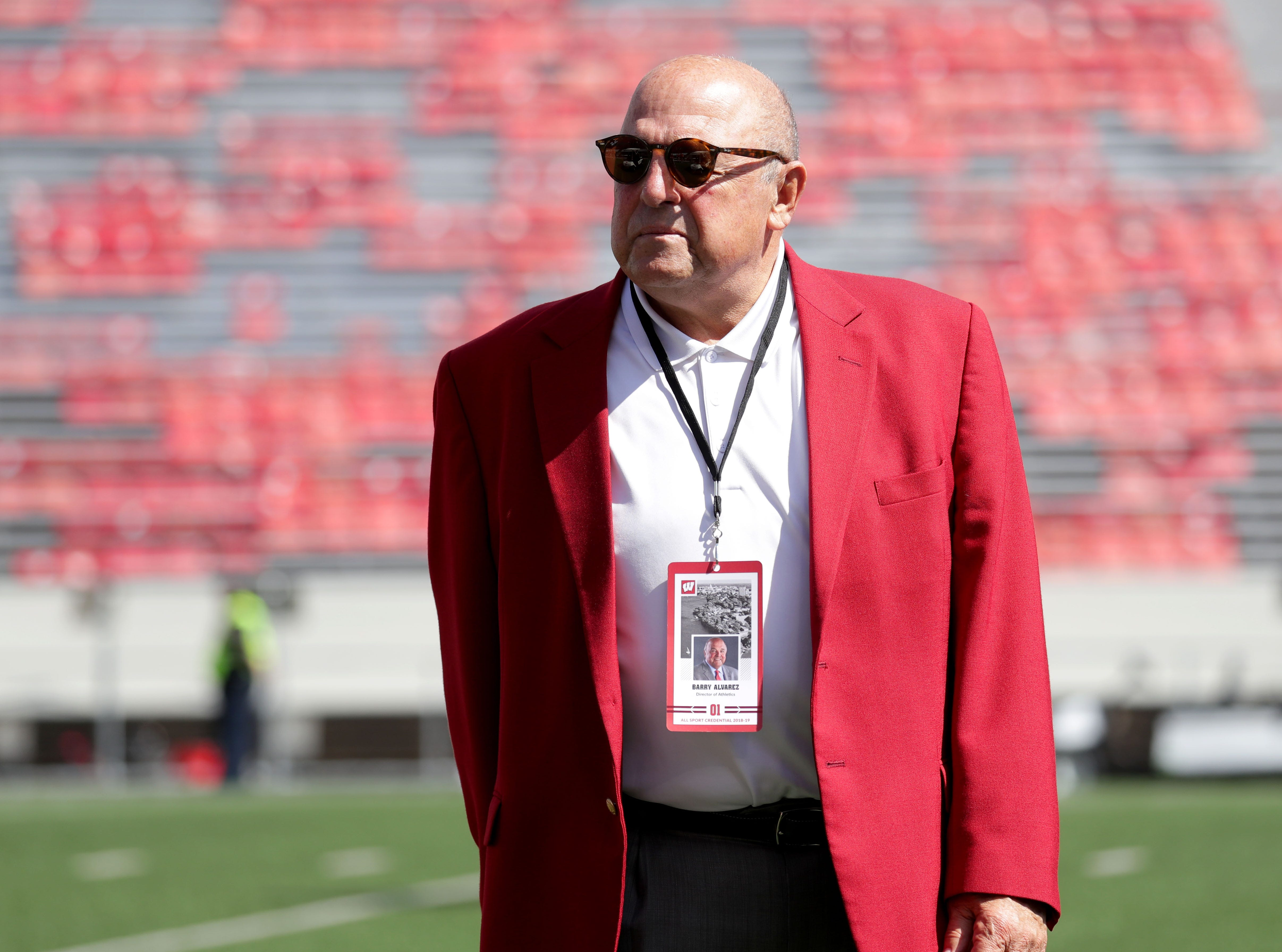 UW Athletic Director Barry Alvarez walks on the field before Wisconsin's game against BYU on Saturday at Camp Randall Stadium.