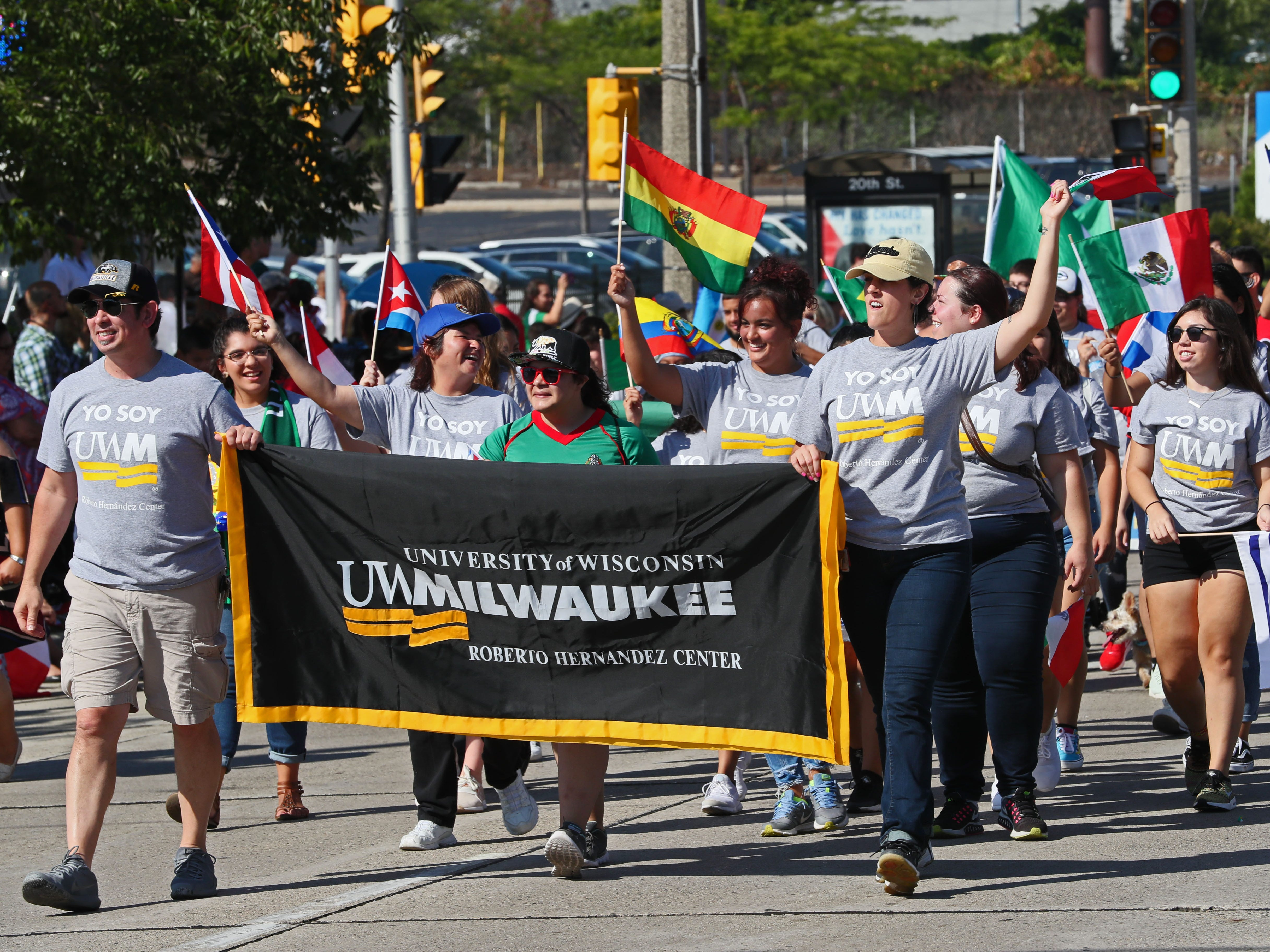 A group representing the University of Wisconsin-Milwaukee marches in the parade.