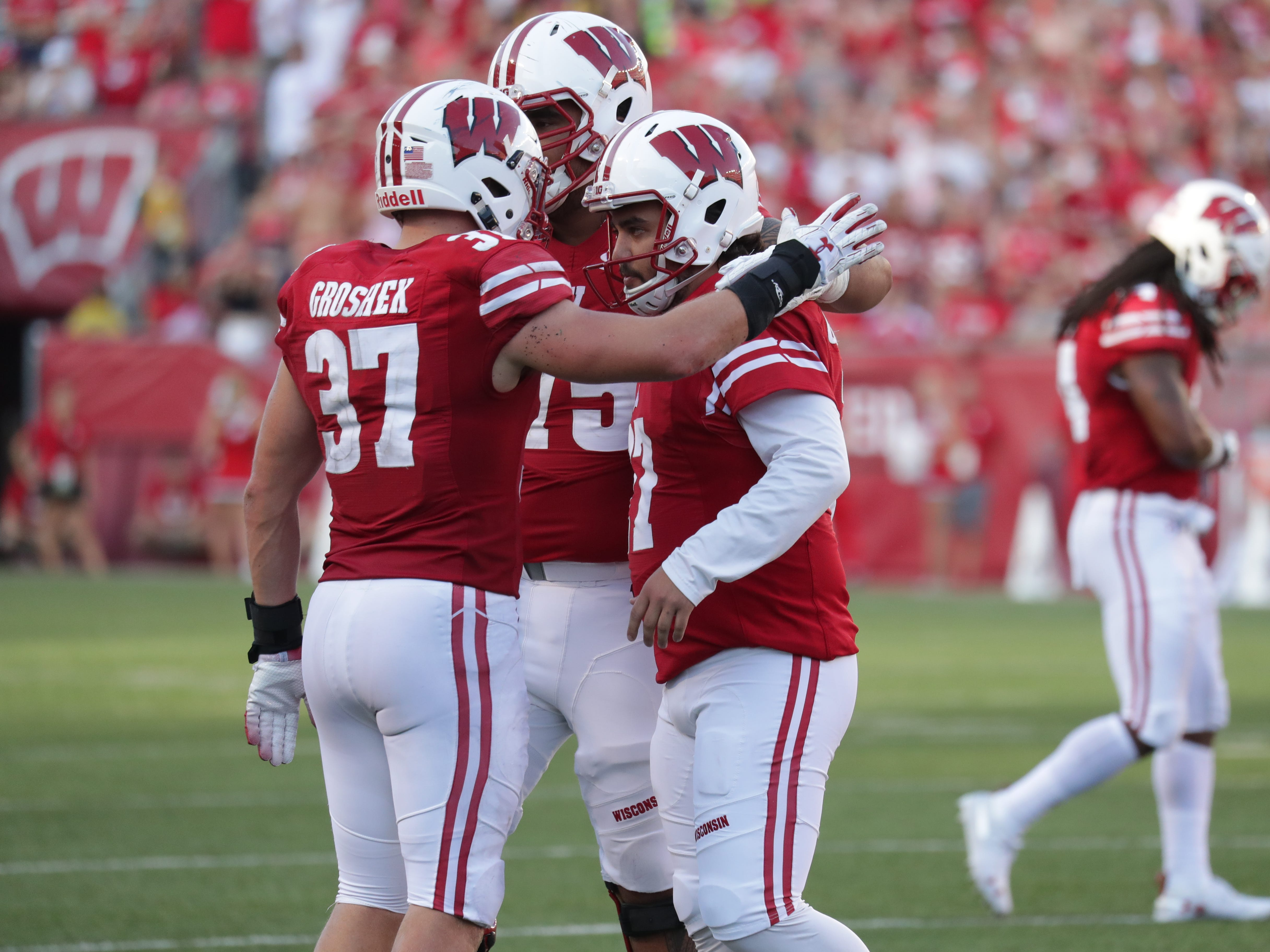 Wisconsin Badgers kicker Rafael Gaglianone gets some support from his teammates after he missed a 42-yard field goal attempt in the fourth quarter.