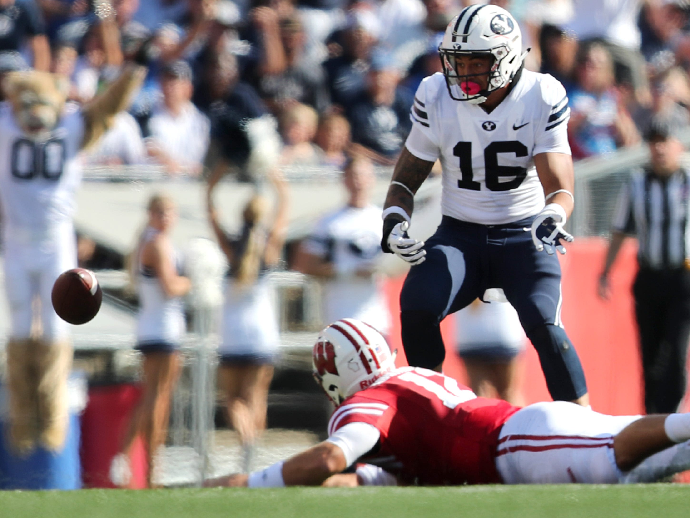 Brigham Young Cougars linebacker Sione Takitaki keeps his eye on the ball after Wisconsin quarterback Alex Hornibrook was called for intentional grounding.