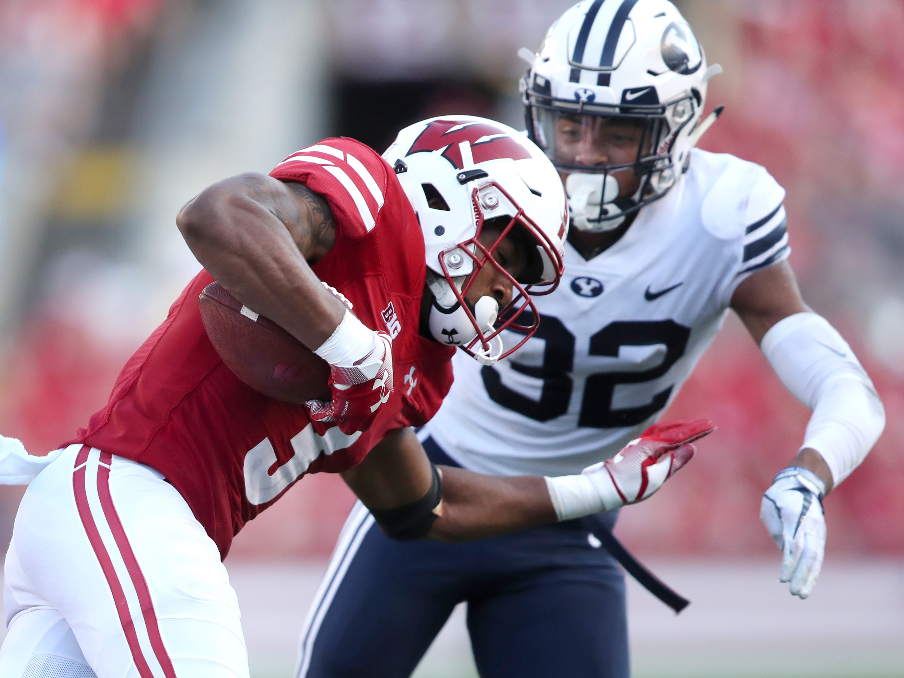 Wisconsin Badgers wide receiver Kendric Pryor (3) tries to get past Brigham Young defensive back Chris Wilcox.