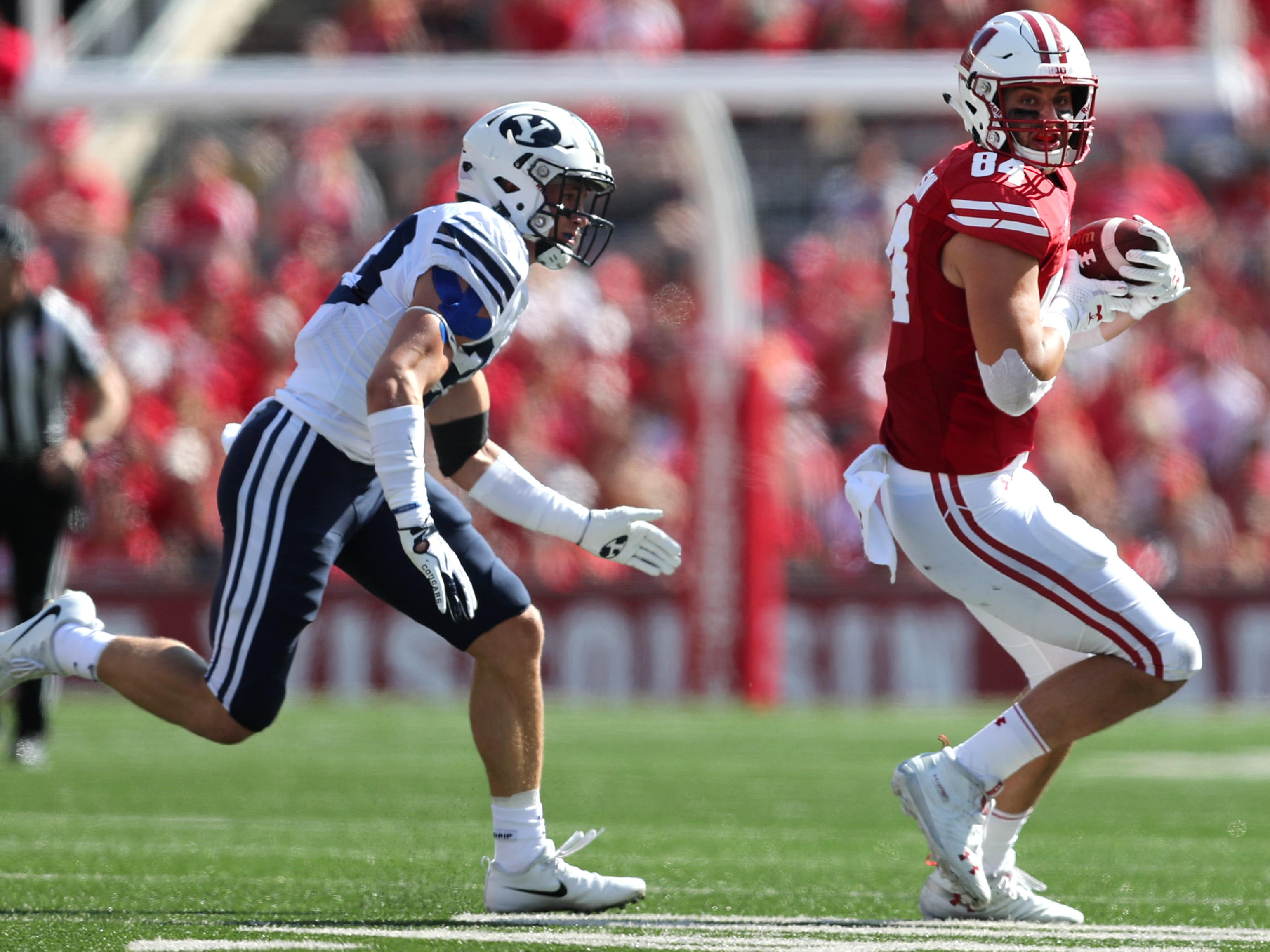 Wisconsin tight end Jake Ferguson makes a catch as Brigham Young linebacker Zayne Anderson closes in for a tackle.