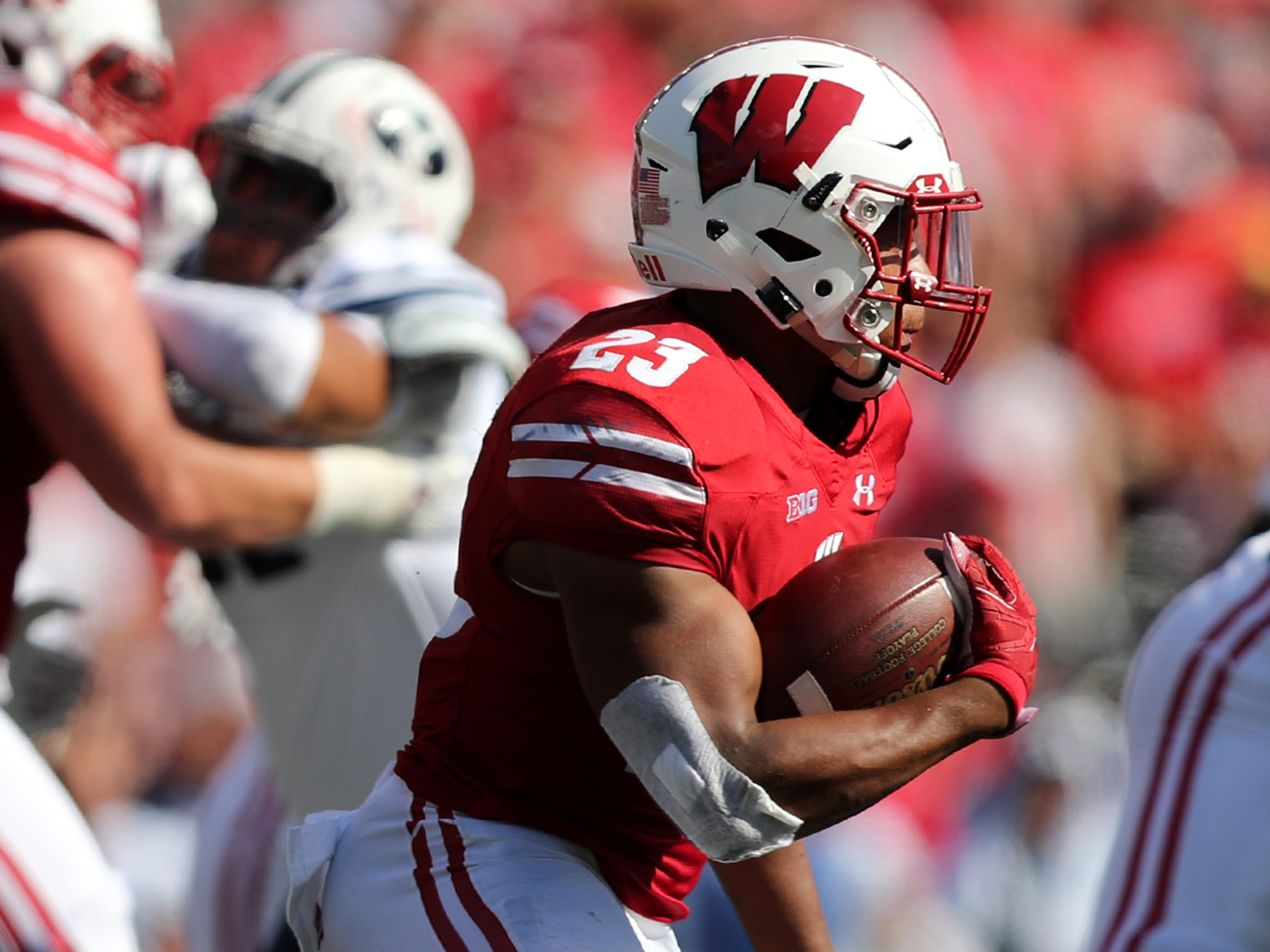 Wisconsin Badgers running back Jonathan Taylor works his way against BYU.