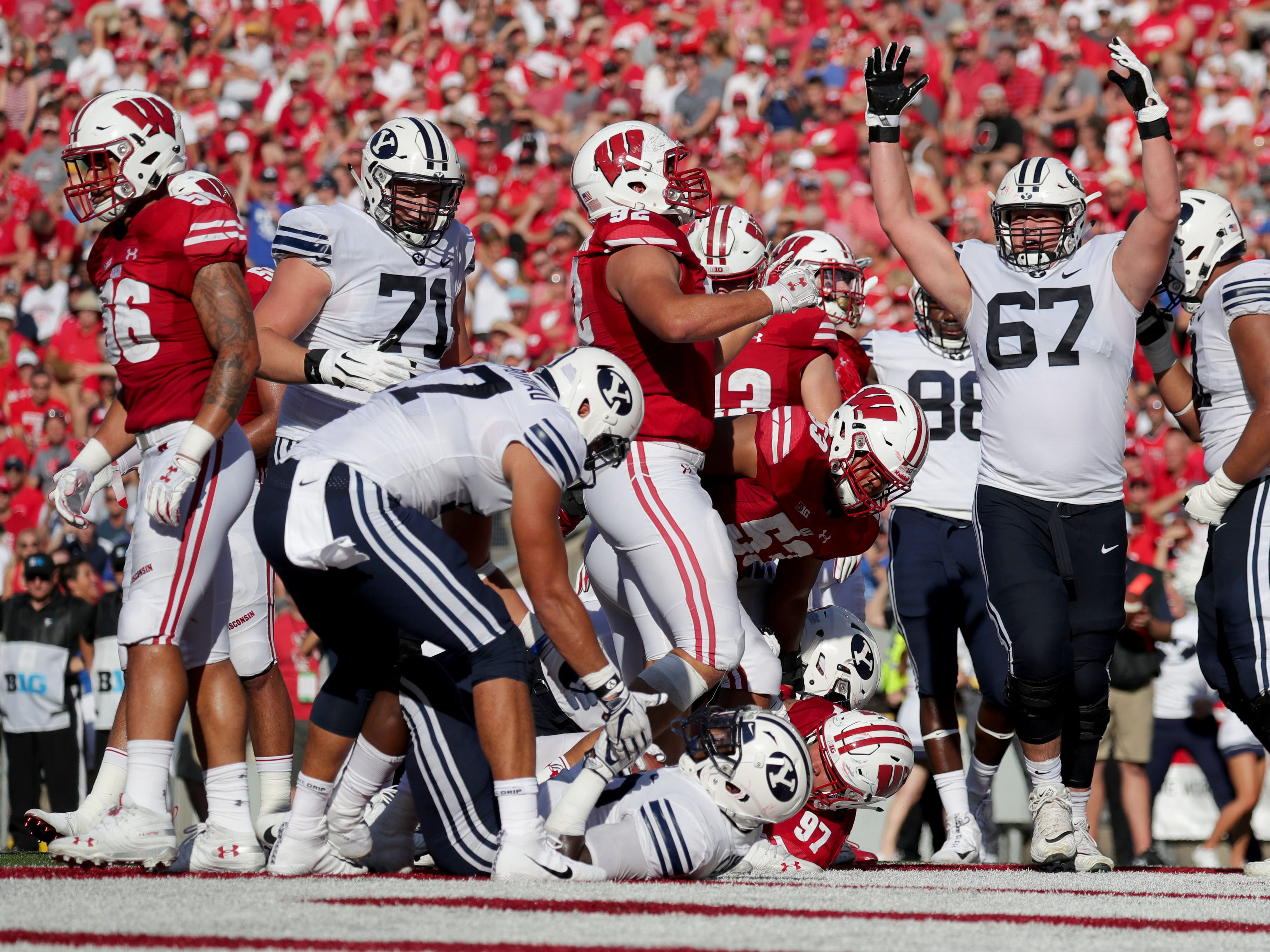 Brigham Young offensive lineman Brady Christensen signals touchdown after Squally Canada's 2-yard touchdown run in the third quarter.