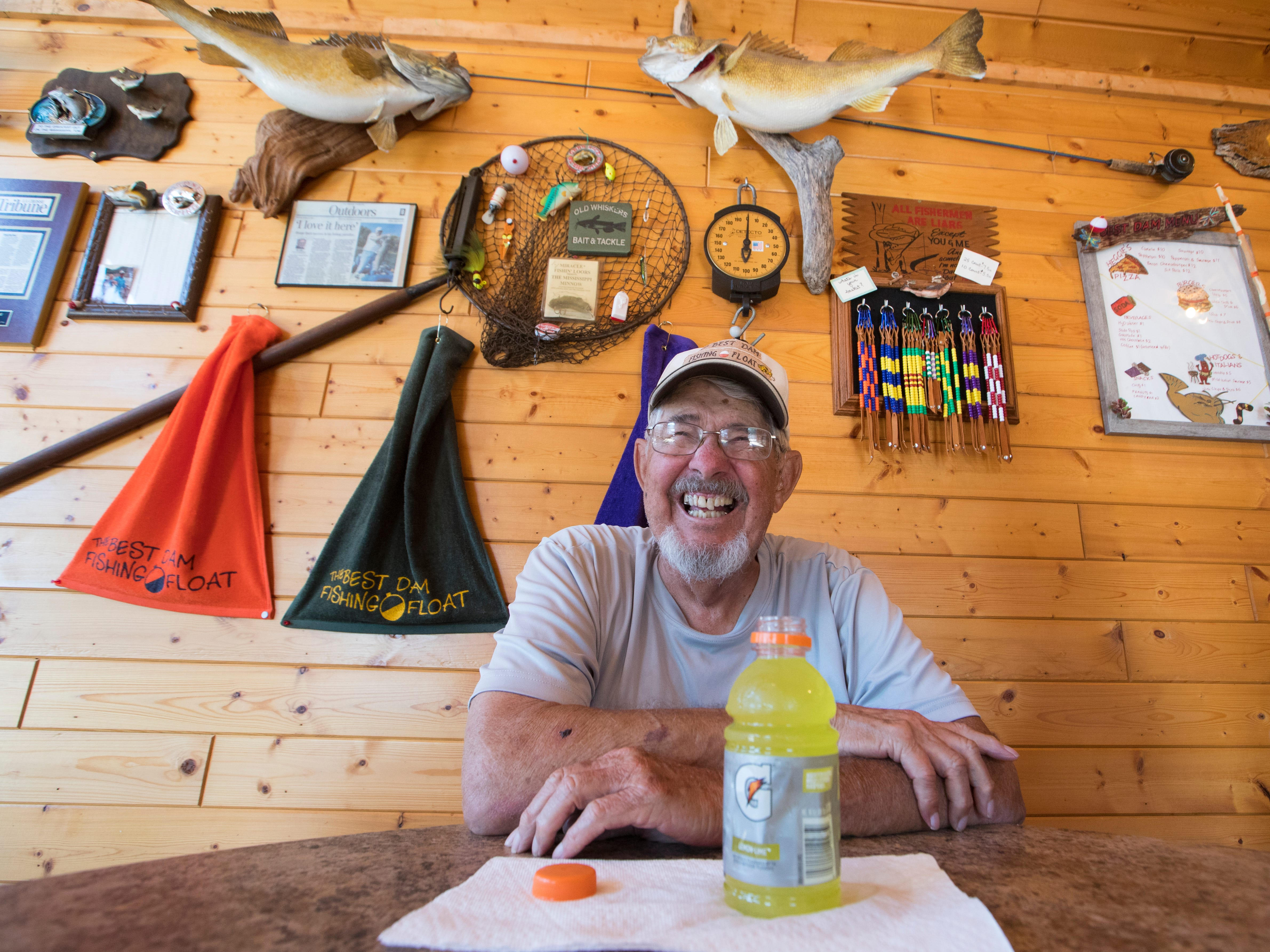 Elwyn Bean takes a break from fishing Sunday on the Best Dam Fishing Float on the Mississippi River in La Crosse. The floating dock, located on the. Wisconsin side, caters to anglers who want to fish a hot spot below Lock & Dam No. 7. Anglers wanting to patronize the dock flip a sign on a boat landing on the Minnesota side of the river signaling someone to pick them up by boat.
