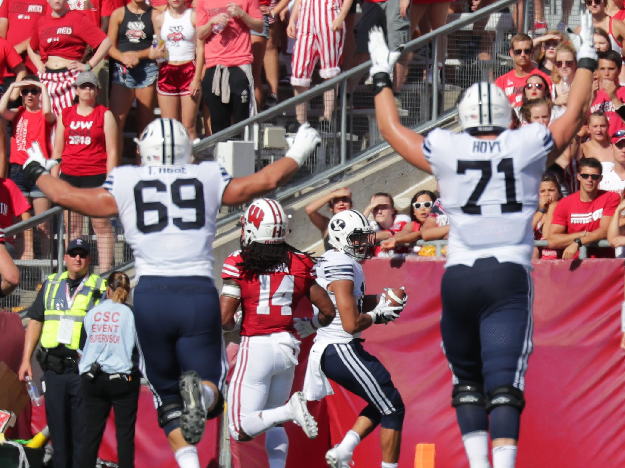 Members of the Brigham Young offensive line celebrate a touchdown catch by quarterback Stacy Conner during the first half.