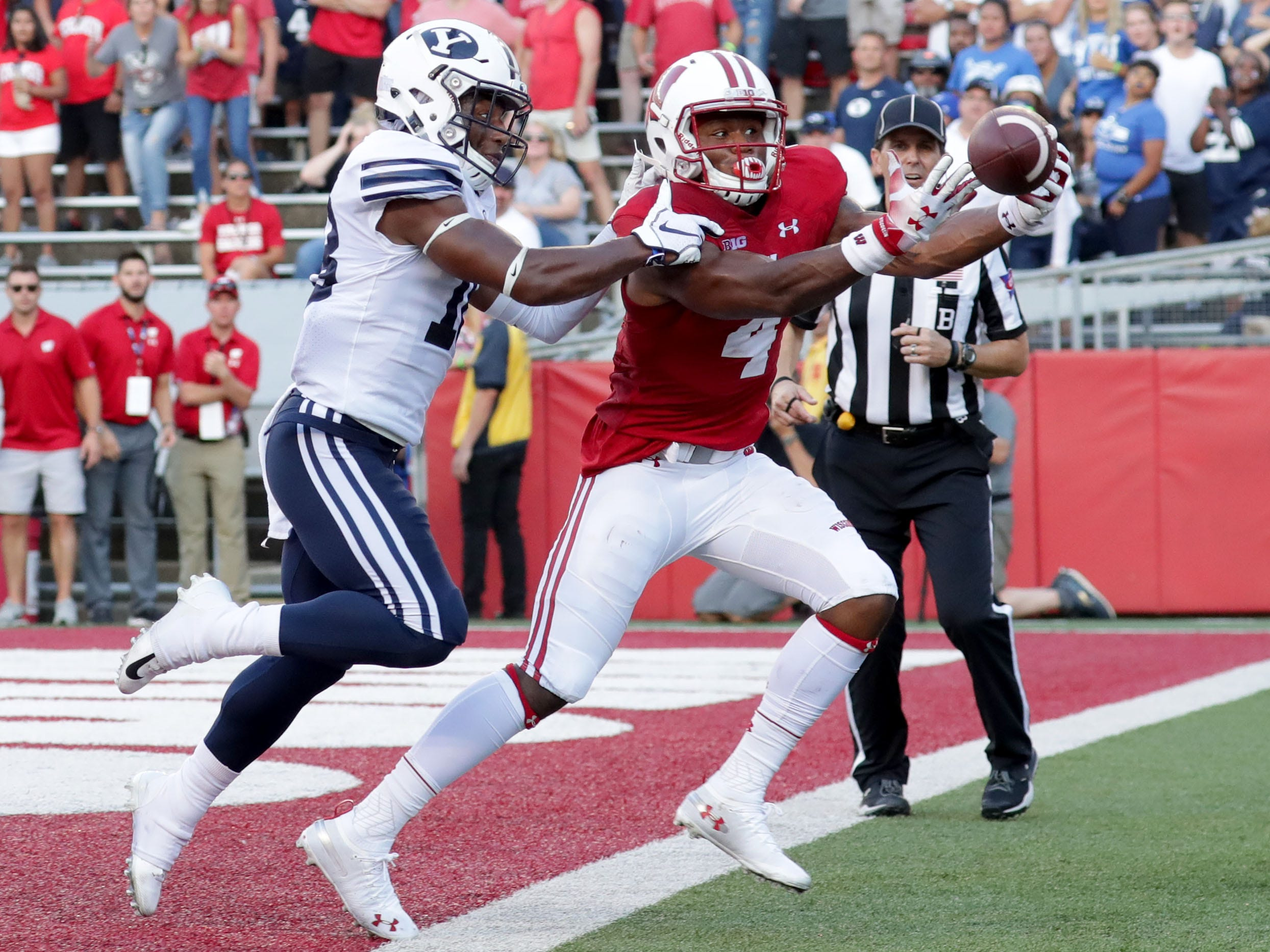 Wisconsin Badgers wide receiver A.J. Taylor (4) can't haul in a pass while defended by Brigham Young linebacker Sione Takitaki.