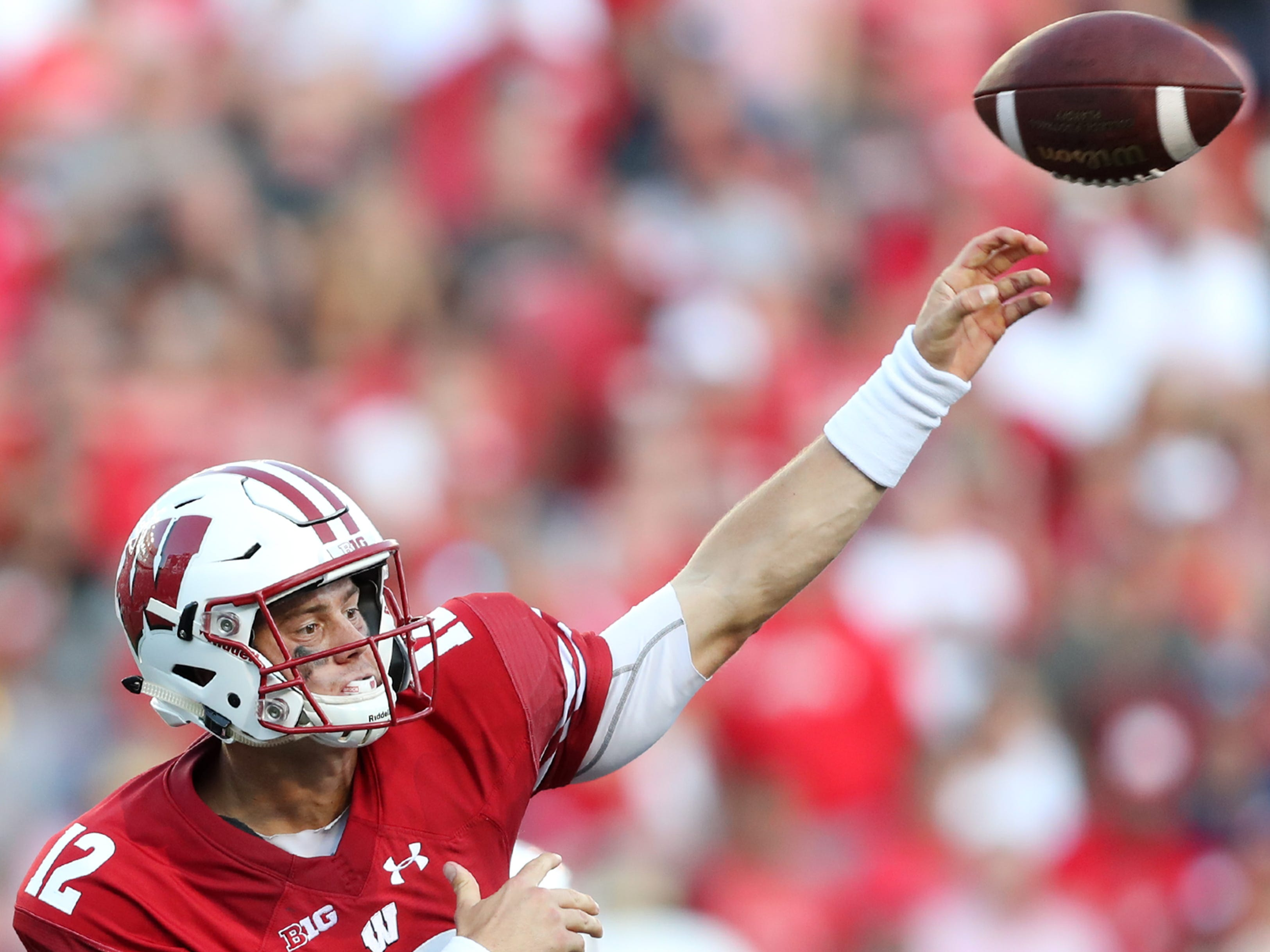 Wisconsin quarterback Alex Hornibrook passes the ball against Brigham Young.