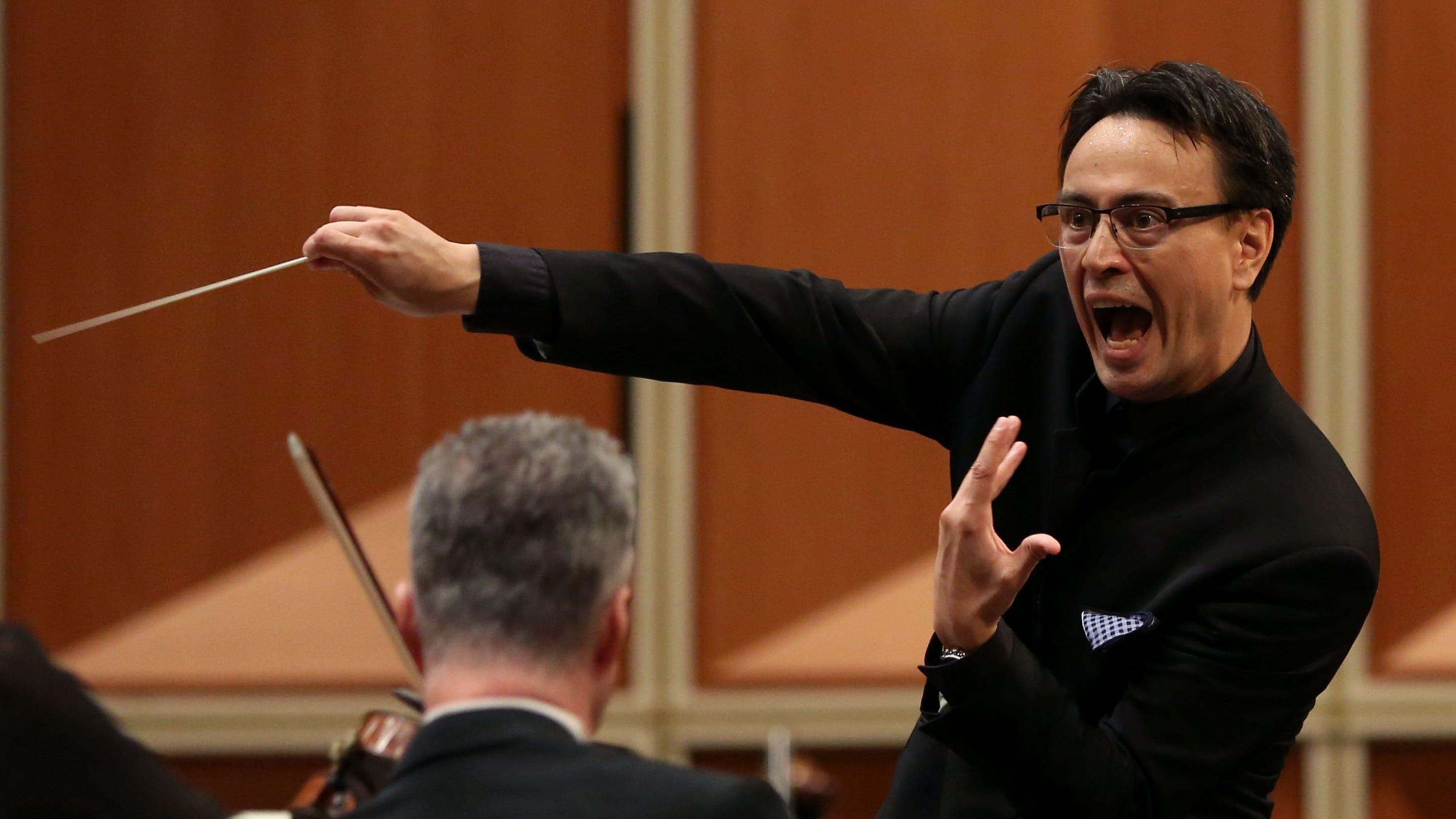 Guest conductor Ken-David Masur leads the...