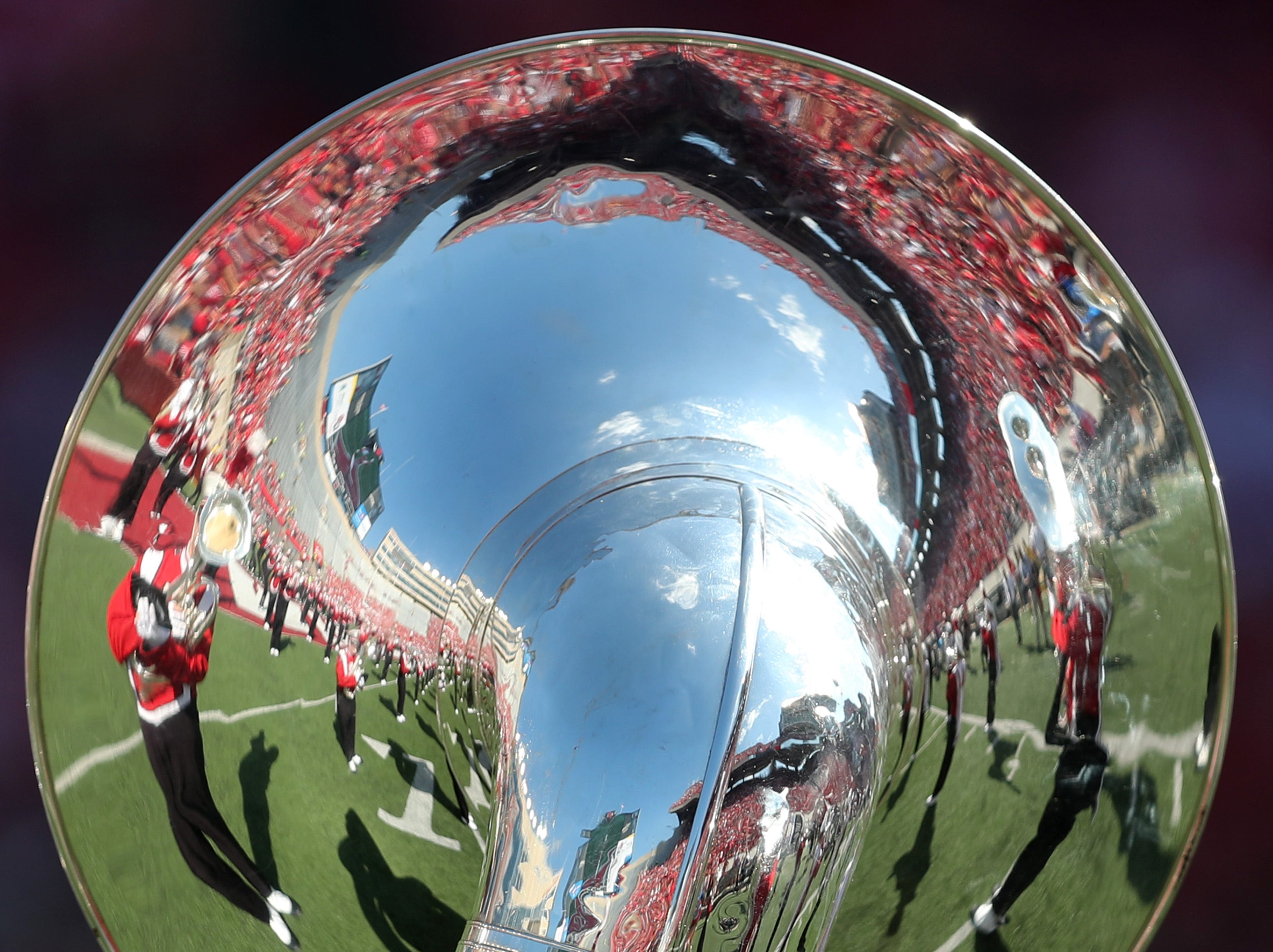 Camp Randall Stadium is reflected in a tuba before the Badgers played Brigham Young.
