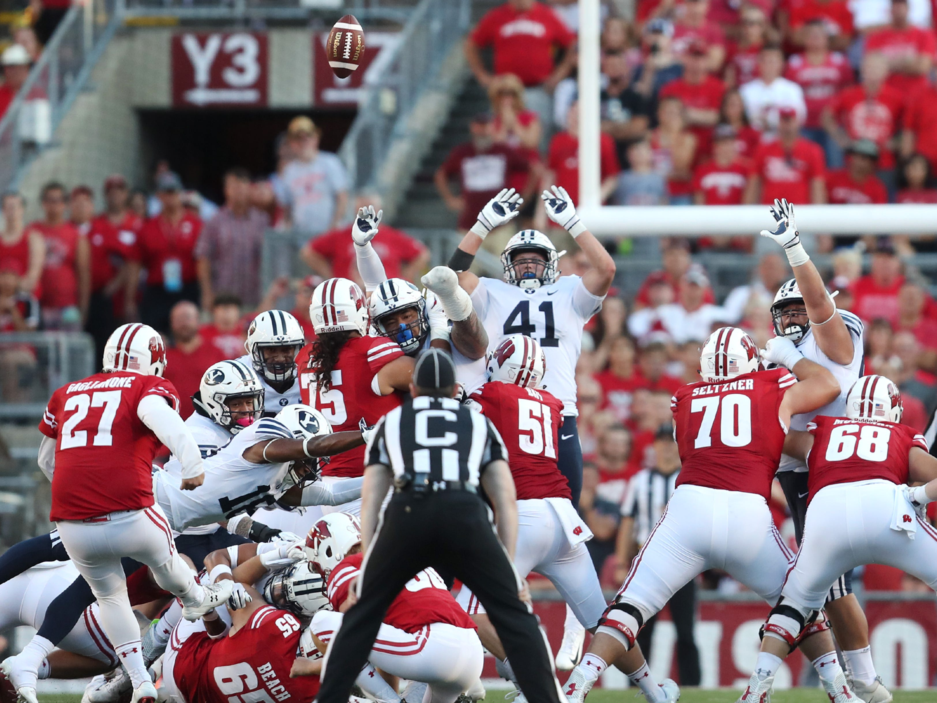 Wisconsin Badgers kicker Rafael Gaglianone (27) misses a 42-yard field goal attempt that would have tied their game against the Brigham Young Cougars on Saturday.