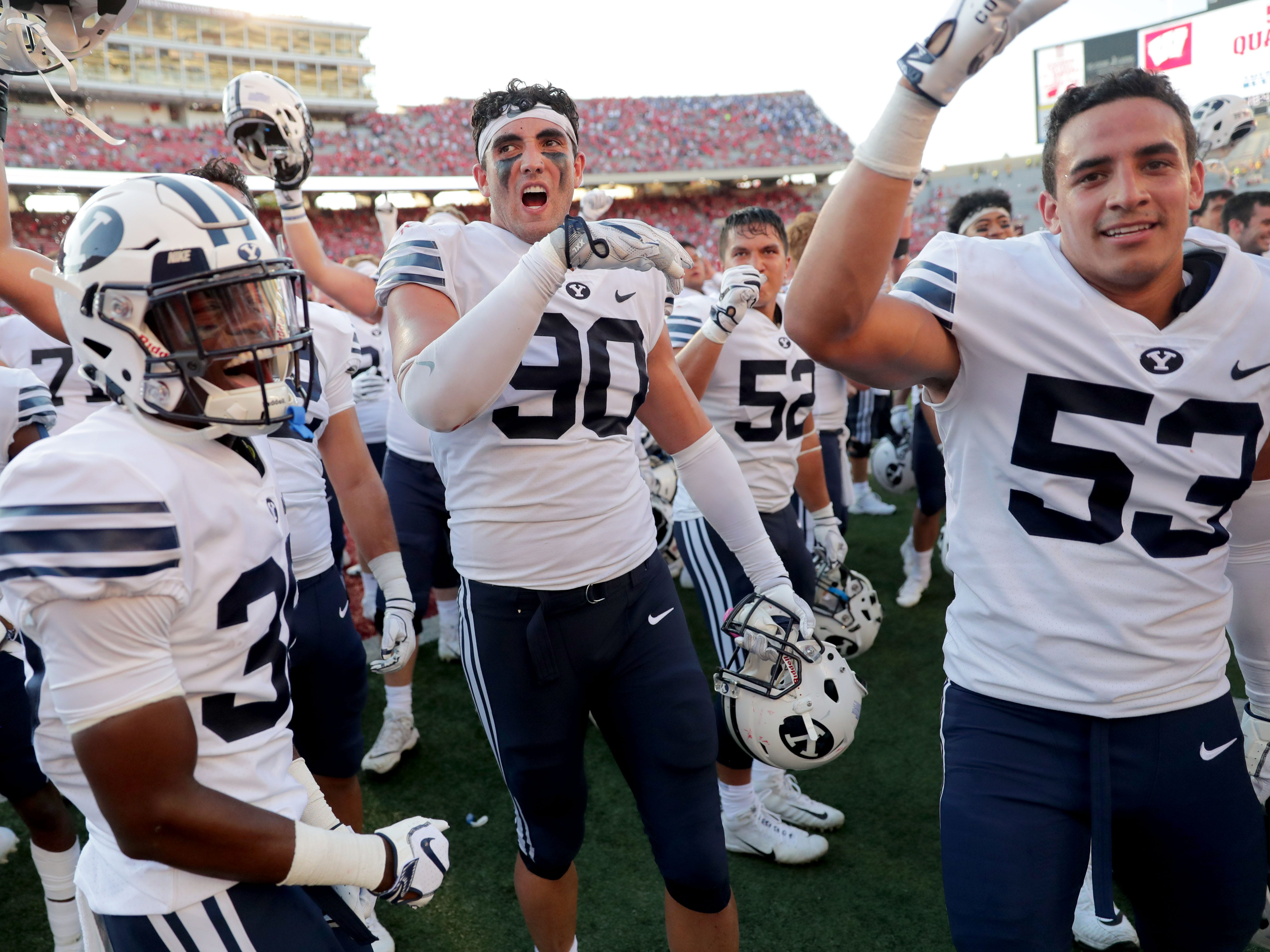 BYU players celebrate after beating Wisconsin, 24-21, Saturday at Camp Randall Stadium.
