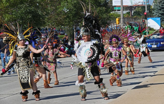 Dancers from Guerreros Azteca (Aztec Warriors) Milwaukee participate in the Mexican Independence Parade near South 20th Street and West Oklahoma Avenue on Sunday.