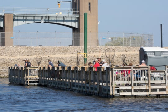 People fish from the float, which caters to anglers who want to fish a hot spot below Lock & Dam No. 7.