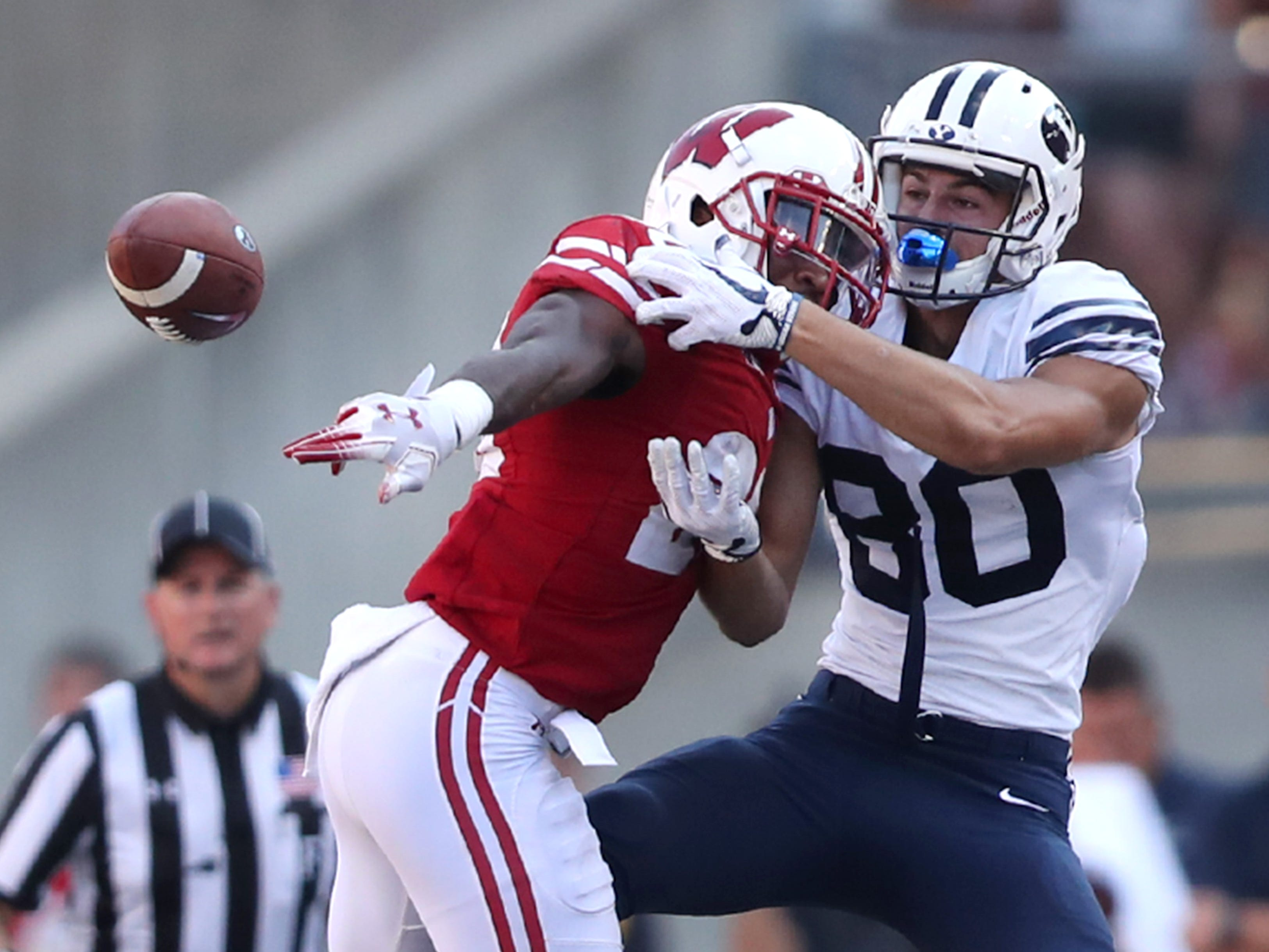 Wisconsin Badgers cornerback Faion Hicks breaks up a pass meant for Brigham Young wide receiver Gunner Romney.