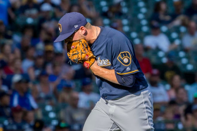 Brewers relief pitcher Corbin Burnes reacts on his way back to the dugout after the top of the ninth after giving up a costly run to the Pirates on Sunday afternoon at Miller Park.