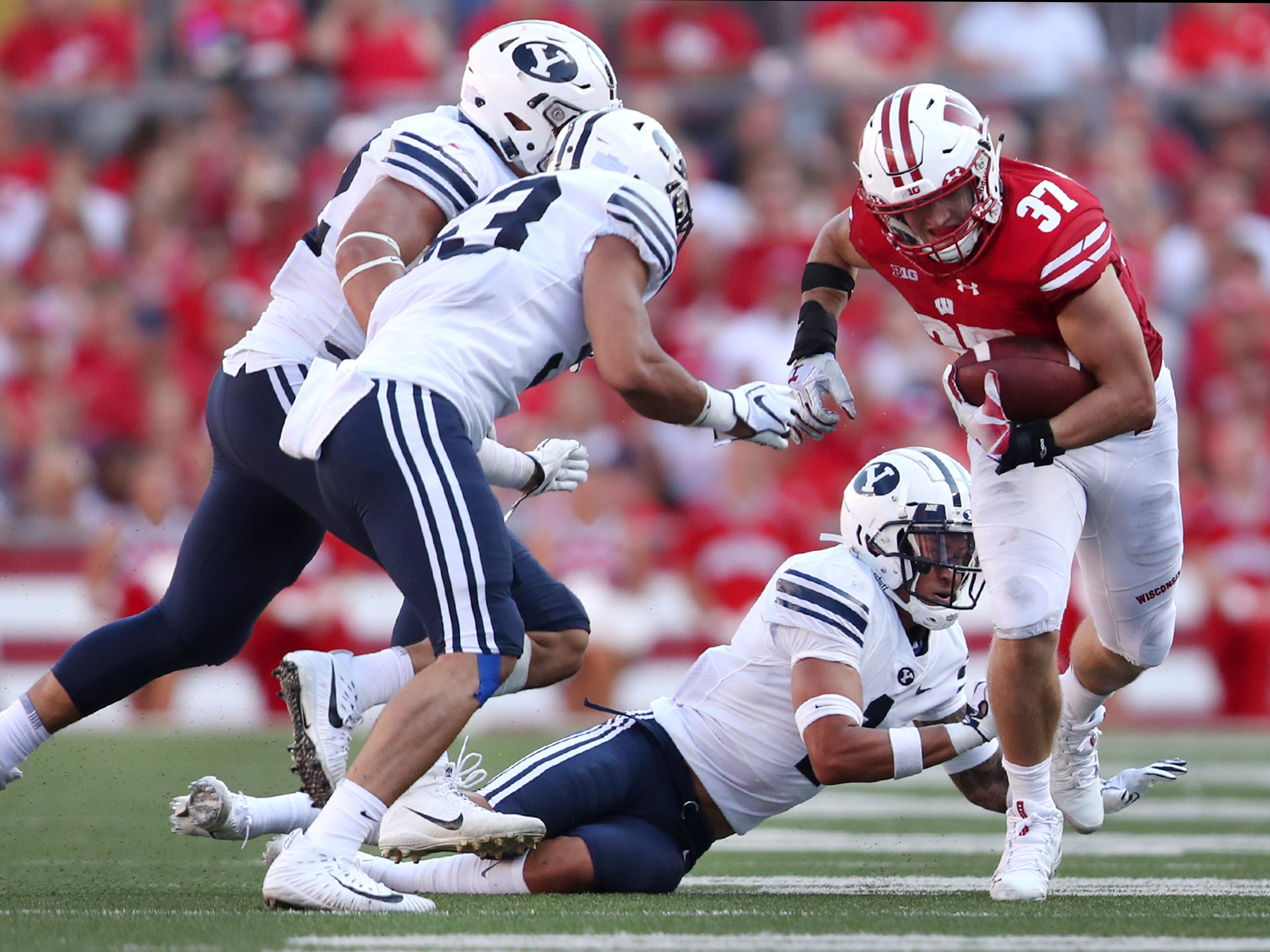 Wisconsin Badgers running back Garrett Groshek (37) tries to push past the Brigham Young defense at Camp Randall Stadium.