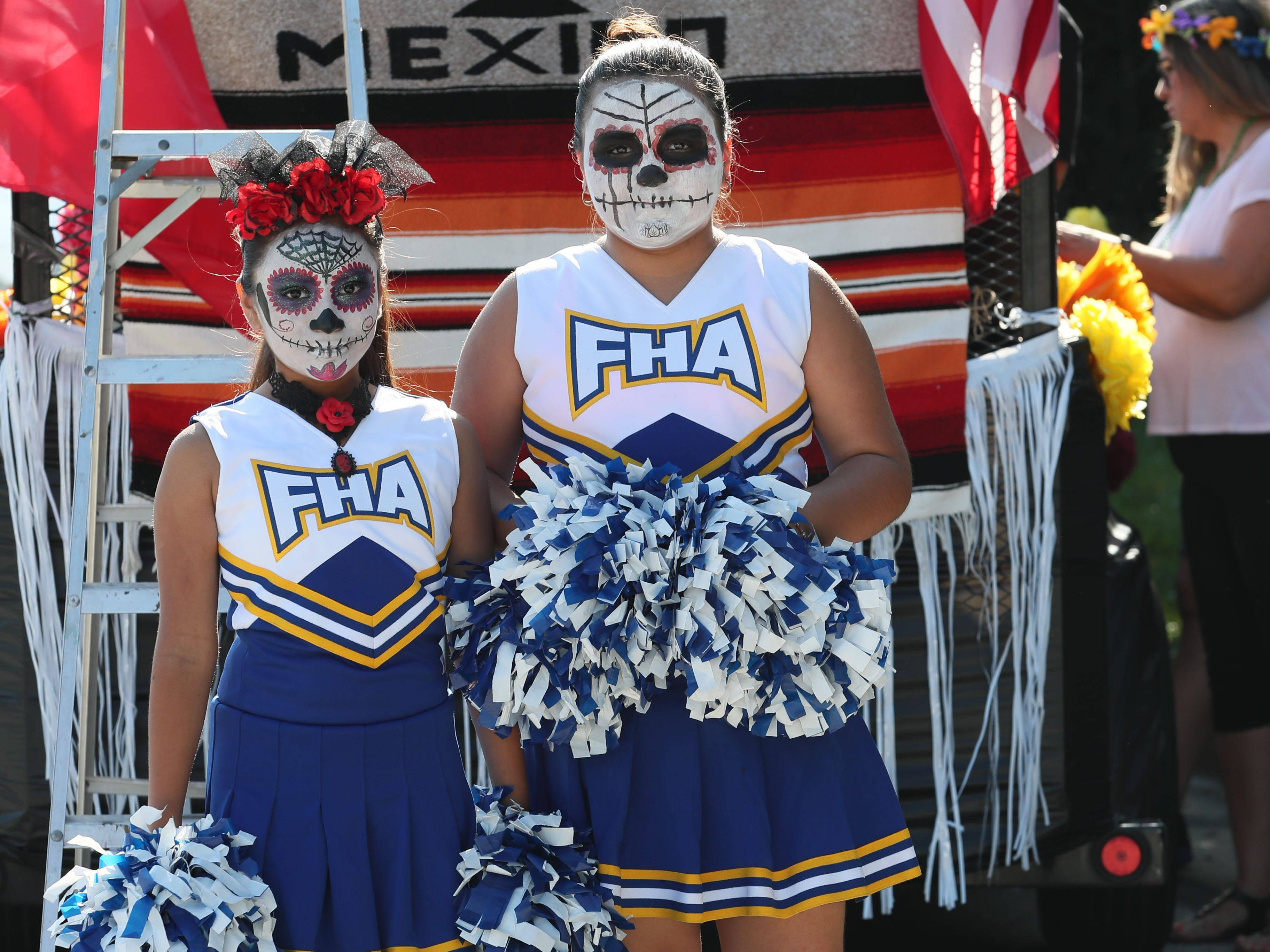 Jocelyn Rivera (left) and Alessandra Berumen, both 10, from Forest Home Avenue School's pompom squad prepare to march in the parade.  Their makeup recalls the Day of the Dead Mexican holiday.