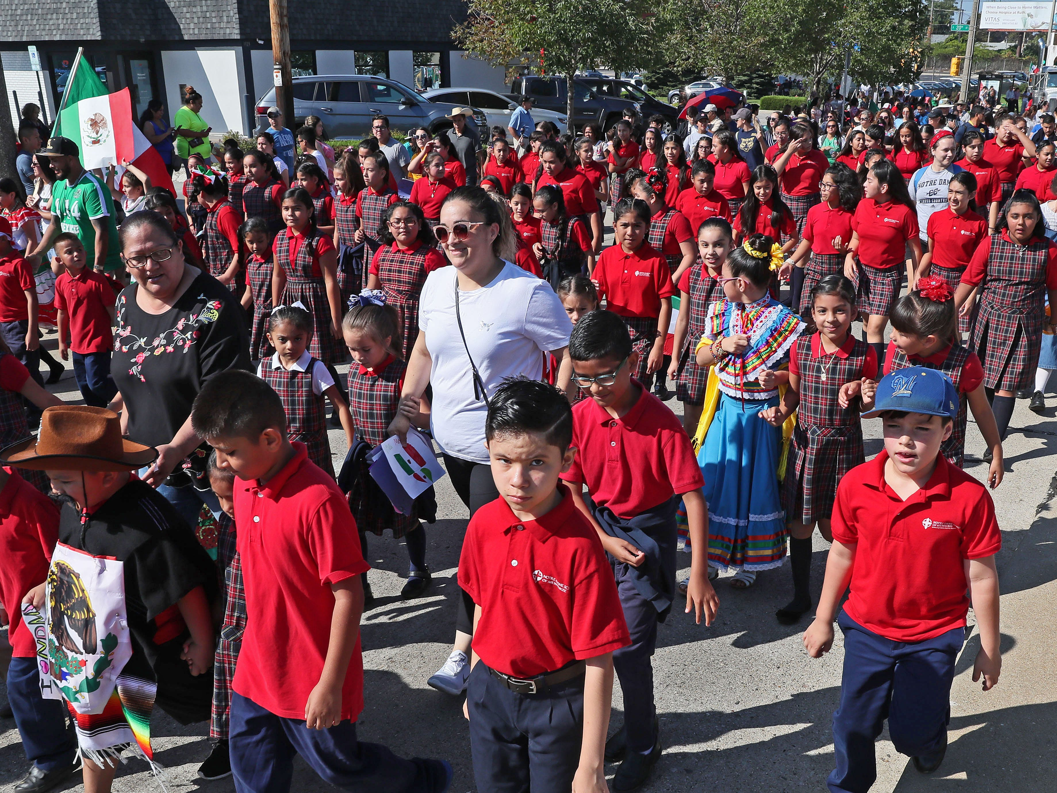 Students from Notre Dame School of Milwaukee walk in the Mexican Independence Parade on Sunday.