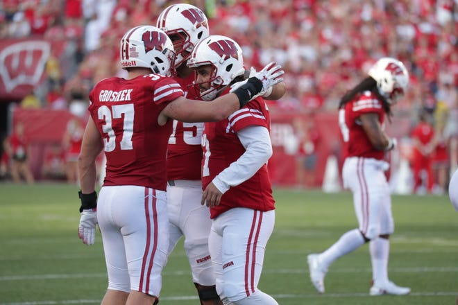 Teammates console Rafael Gaglianone after he missed a 42-yard field goal in the final minute.