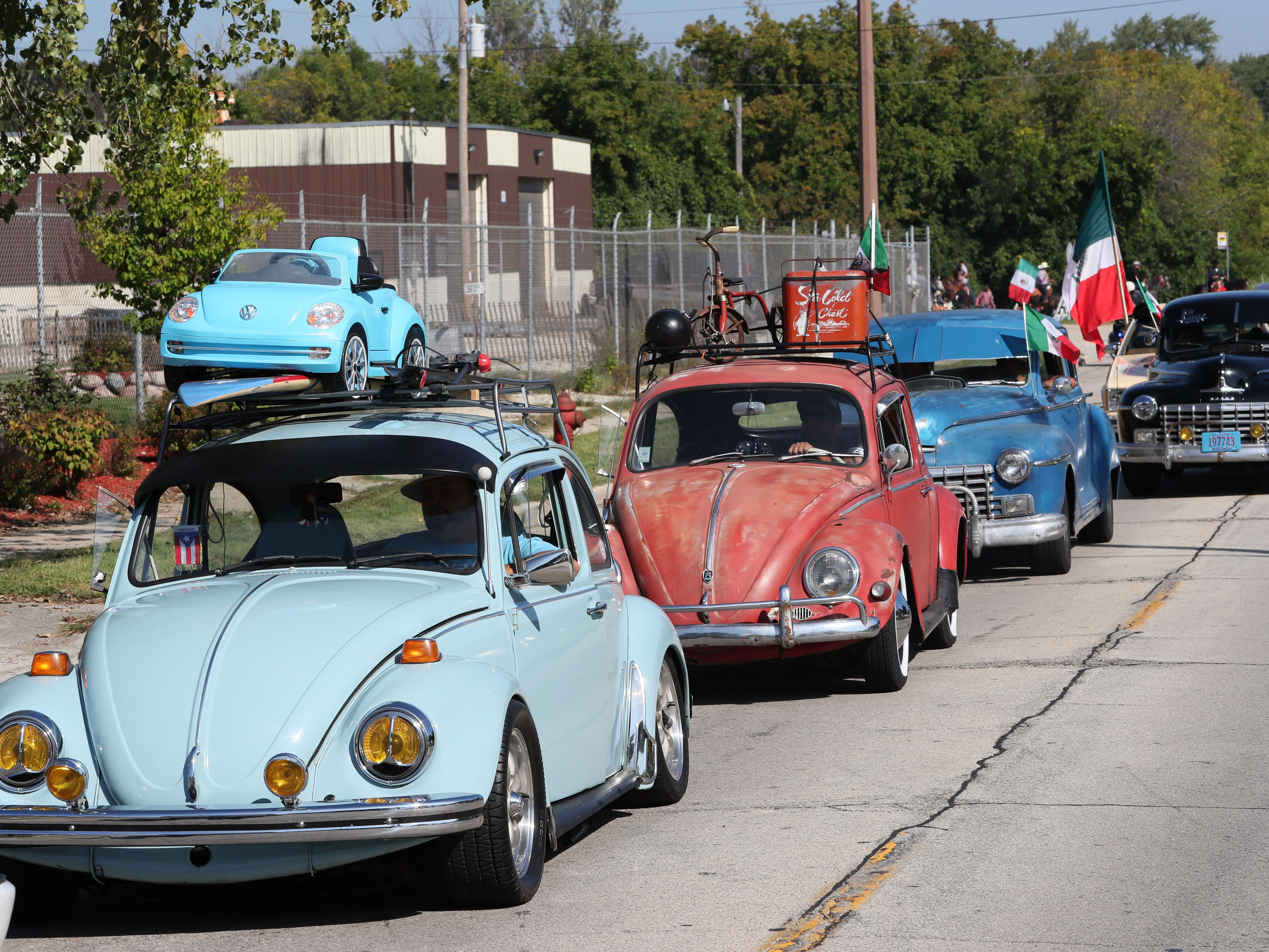A variety of classic cars take part in the parade.