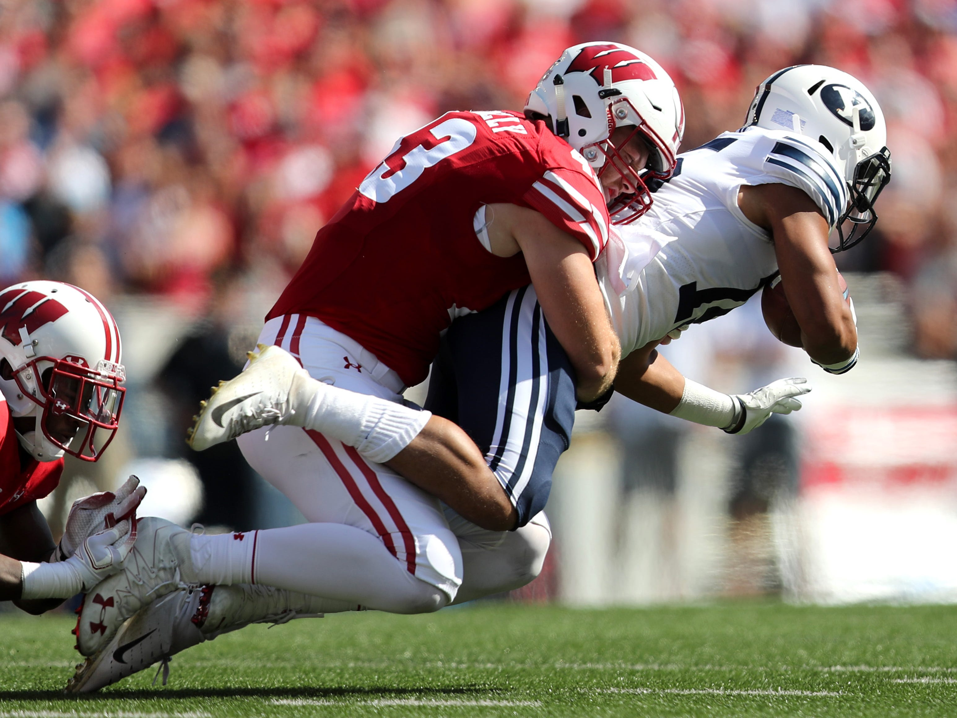 Wisconsin Badgers linebacker Ryan Connelly (43) tackles Brigham Young Cougars wide receiver Aleva Hifo.