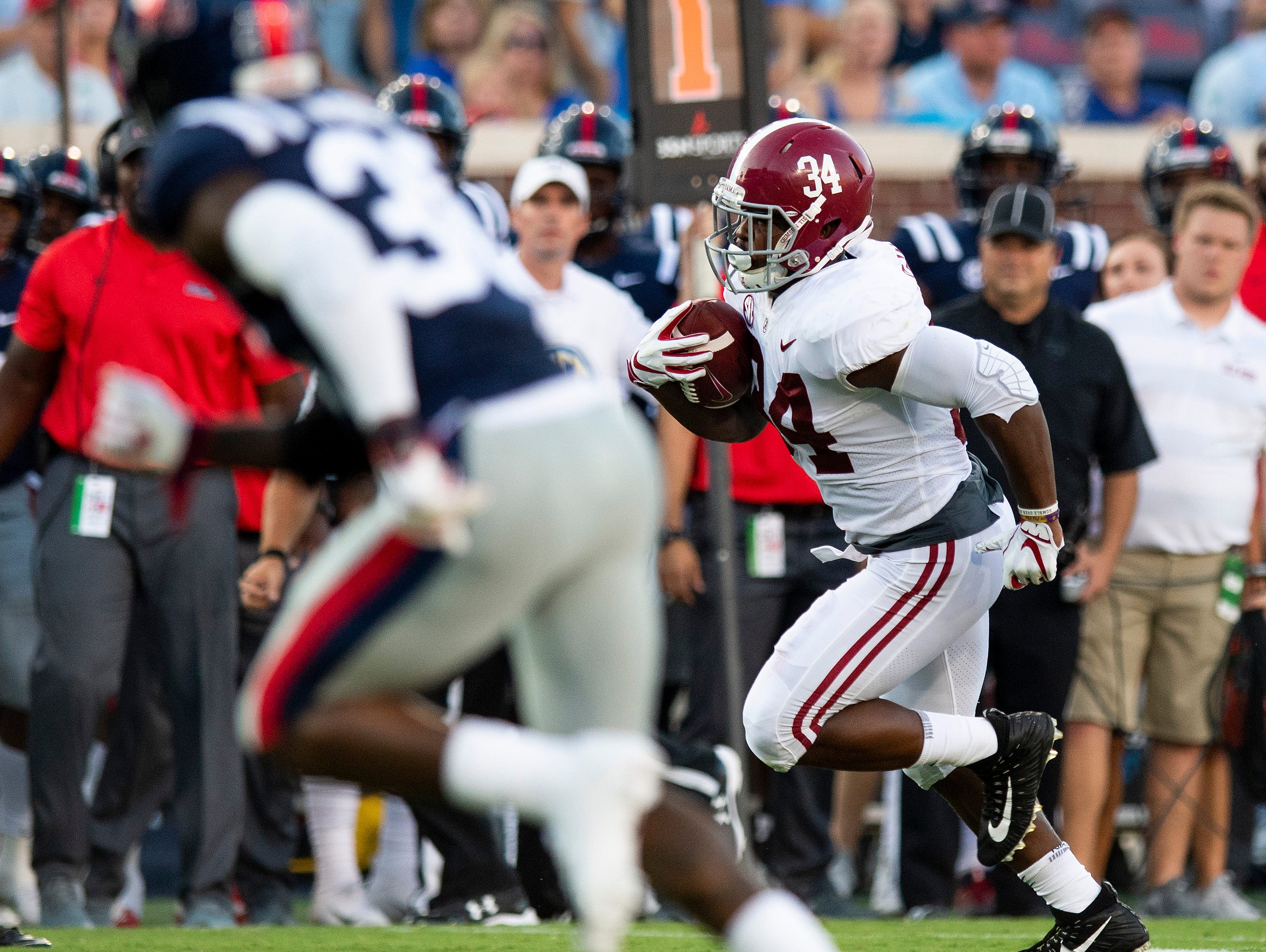 Alabama running back Damien Harris (34) carriers for a touchdown against Ole Miss In first half action in Oxford, Ms., on Saturday September 15, 2018.