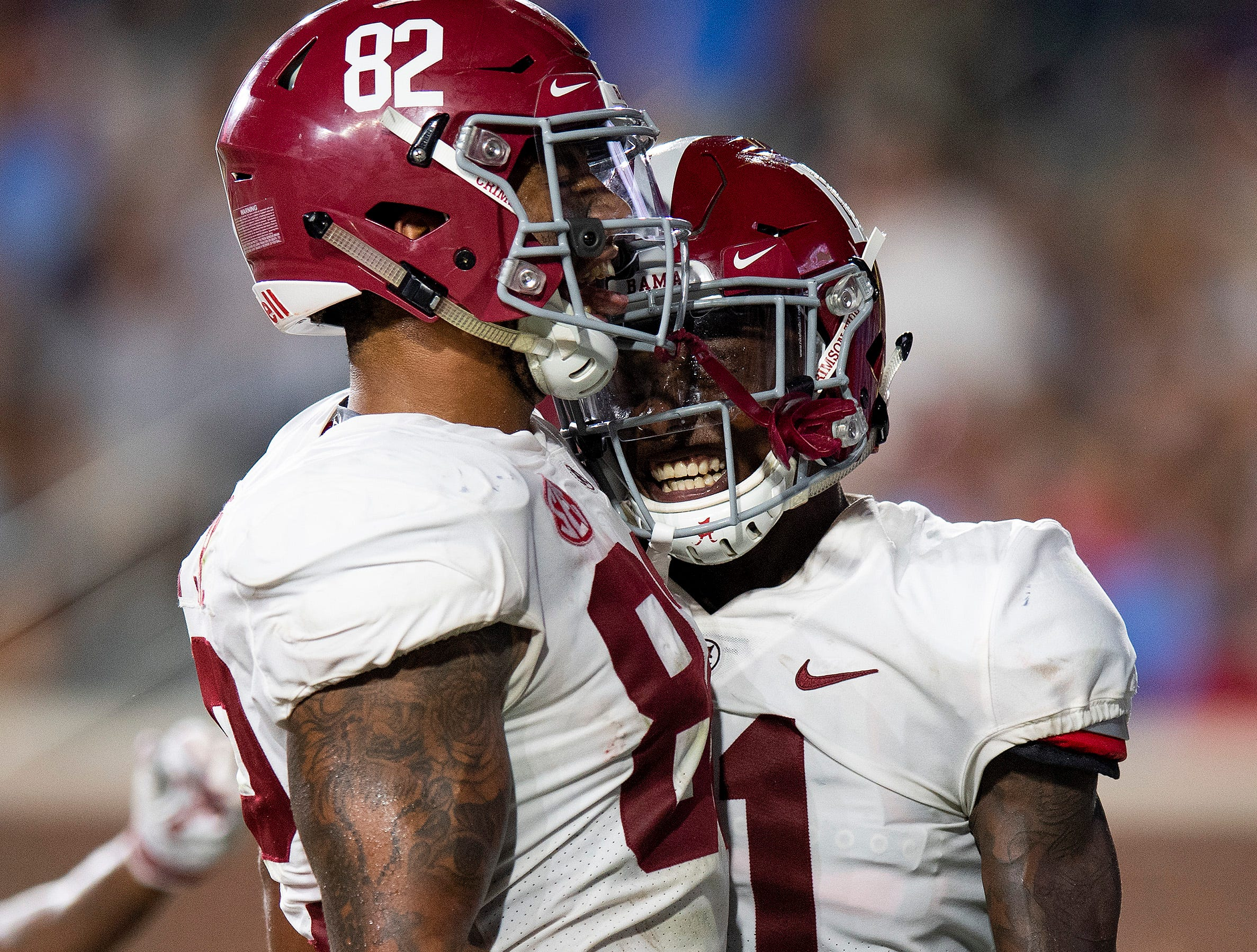 Alabama tight end Irv Smith Jr. (82) and wide receiver Henry Ruggs, III, (11) celebrate Ruggs touchdown catch against Ole Miss In first half action in Oxford, Ms., on Saturday September 15, 2018.