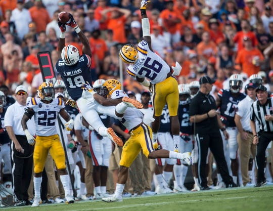 Auburn's Seth Williams (18) catches the ball on the sideline against LSU at Jordan-Hare Stadium in Auburn, Ala., on Saturday, Sept. 15, 2018. LSU defeated Auburn 22-21.