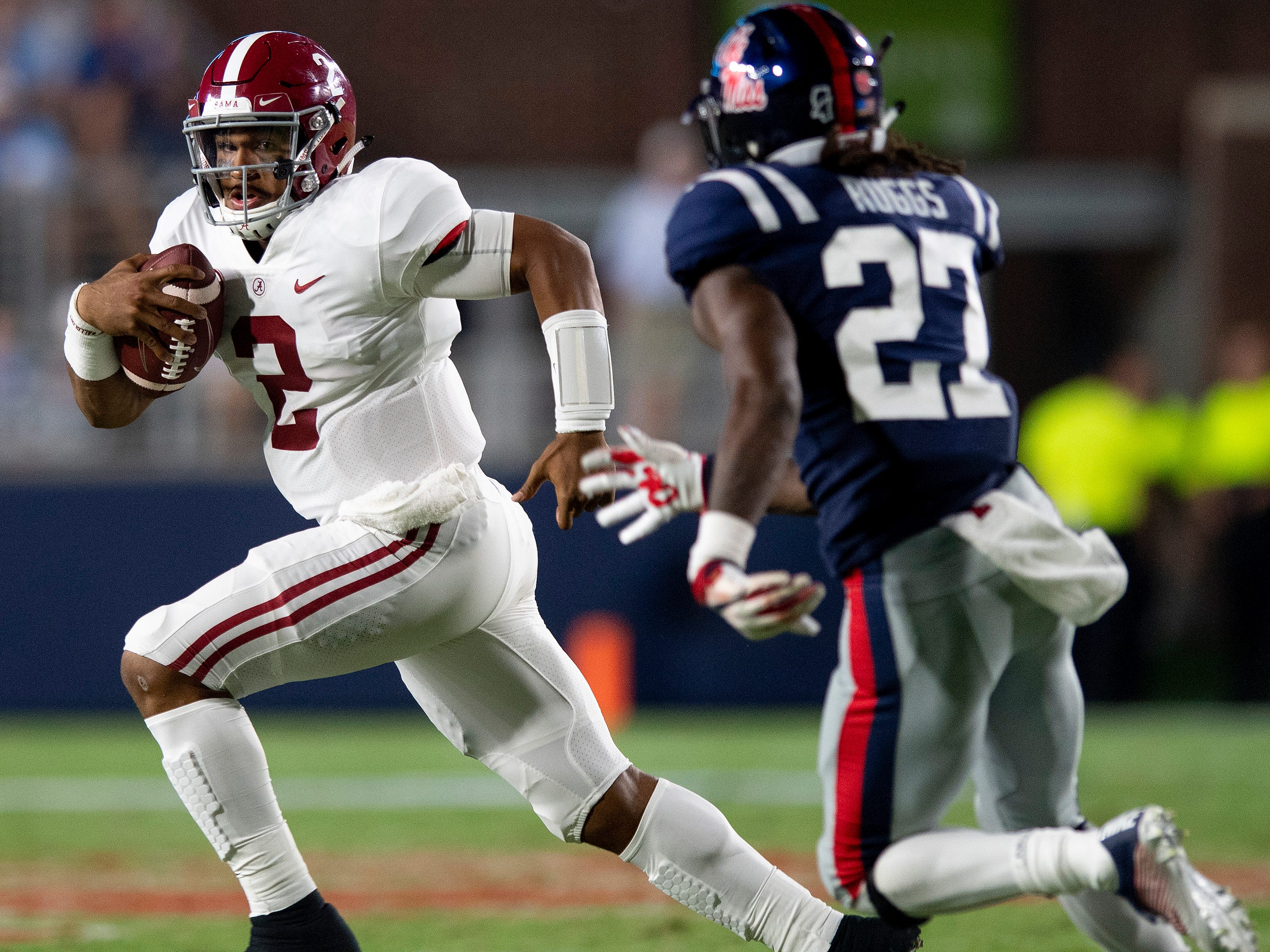 Alabama quarterback Jalen Hurts (2) carries against Ole Miss linebacker Kevontae' Ruggs (27) In first half action in Oxford, Ms., on Saturday September 15, 2018.