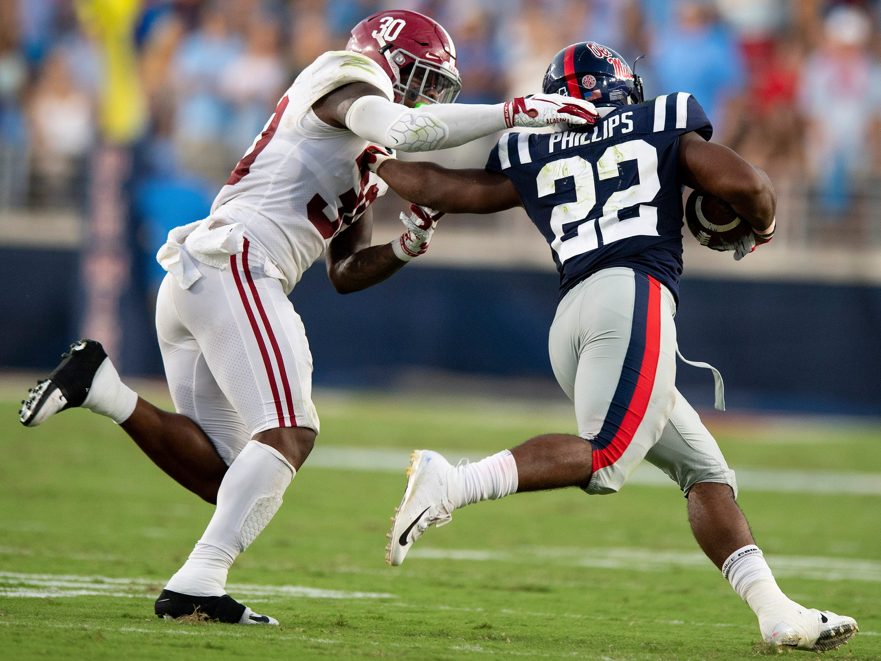 Alabama linebacker Mack Wilson (30) tackles Ole Miss running back Scottie Phillips (22) In first half action in Oxford, Ms., on Saturday September 15, 2018.