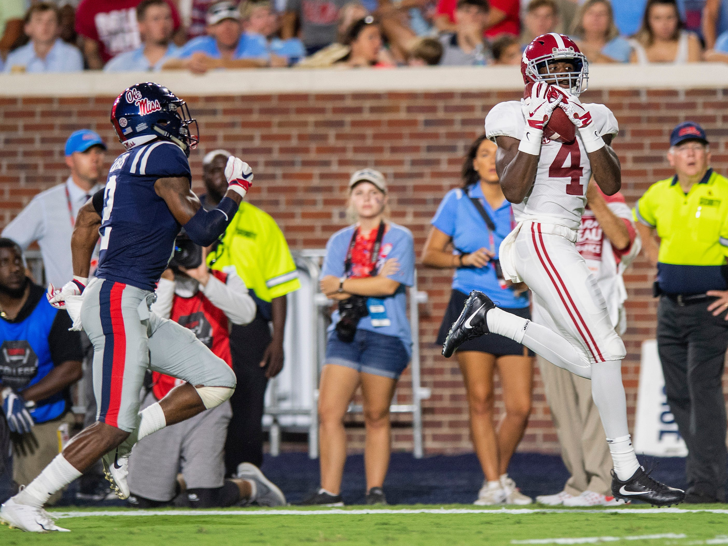 Alabama wide receiver Jerry Jeudy (4) catyches a pass against Ole Miss defensive back Montrell Custis (2) in first half action in Oxford, Ms., on Saturday September 15, 2018.