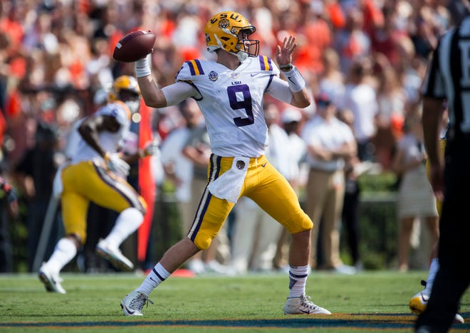 LSU's Joe Burrow (9) throws the ball down field against  Auburn at Jordan-Hare Stadium in Auburn, Ala., on Saturday, Sept. 15, 2018. LSU defeated Auburn 22-21.