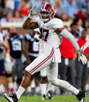 Alabama linebacker Christian Miller (47) makes a shark fin sign after sacking Ole Miss quarterback Jordan Ta'amu (10) In first half action in Oxford, Ms., on Saturday September 15, 2018.