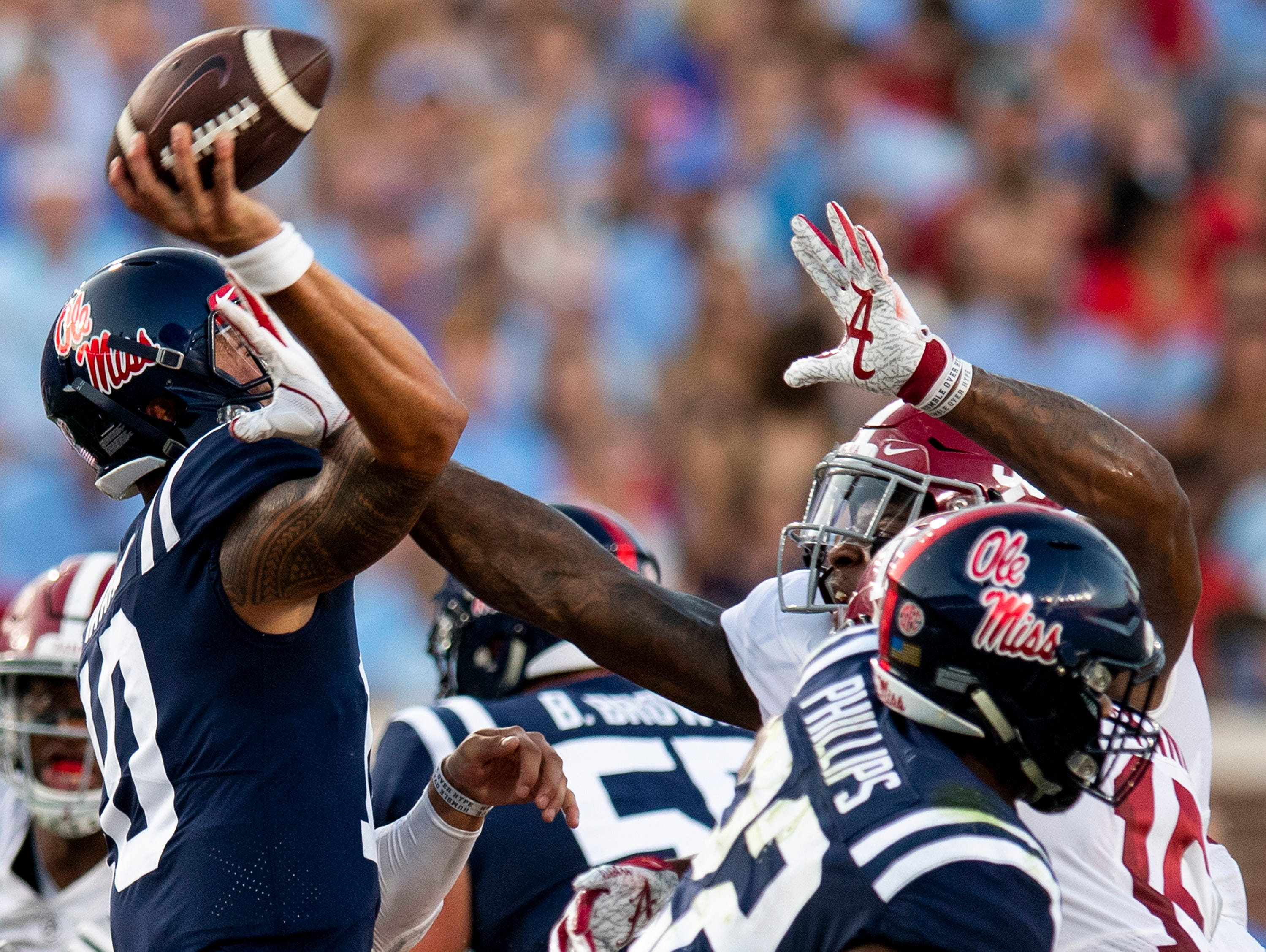 Alabama linebacker Anfernee Jennings (33) gets a hand on Ole Miss quarterback Jordan Ta'amu (10)  as he passes In first half action in Oxford, Ms., on Saturday September 15, 2018.