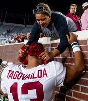 Alabama quarterback Tua Tagovailoa (13) is given a lei by his mother Diane Tagovailoa after Alabama defeated Ole Miss in Oxford, Ms., on Saturday September 15, 2018.