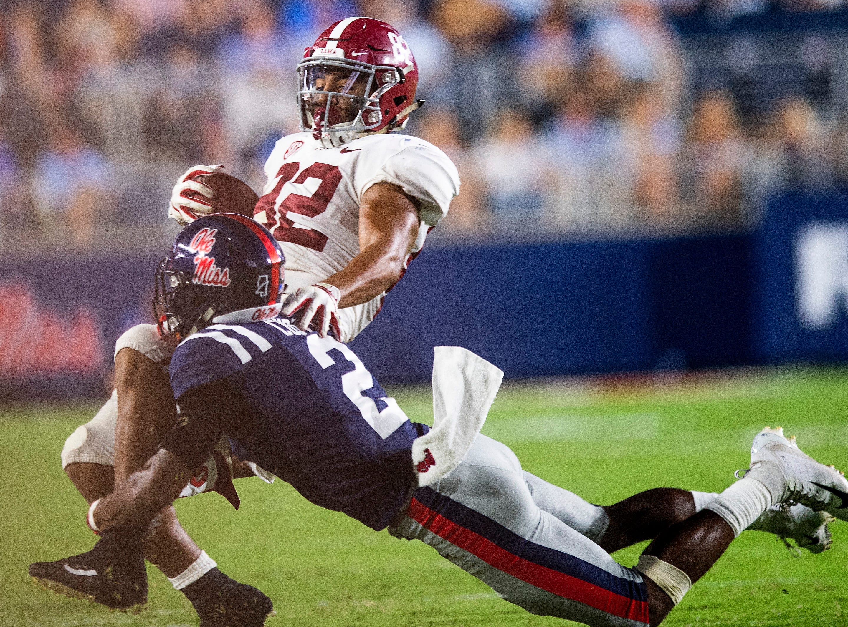 Ole Miss defensive back Montrell Custis (2)  tackles Alabama tight end Irv Smith Jr. (82) in first half action in Oxford, Ms., on Saturday September 15, 2018.