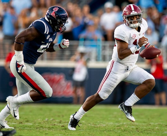 Alabama quarterback Tua Tagovailoa (13) carries against Ole Miss In first half action in Oxford, Ms., on Saturday September 15, 2018.
