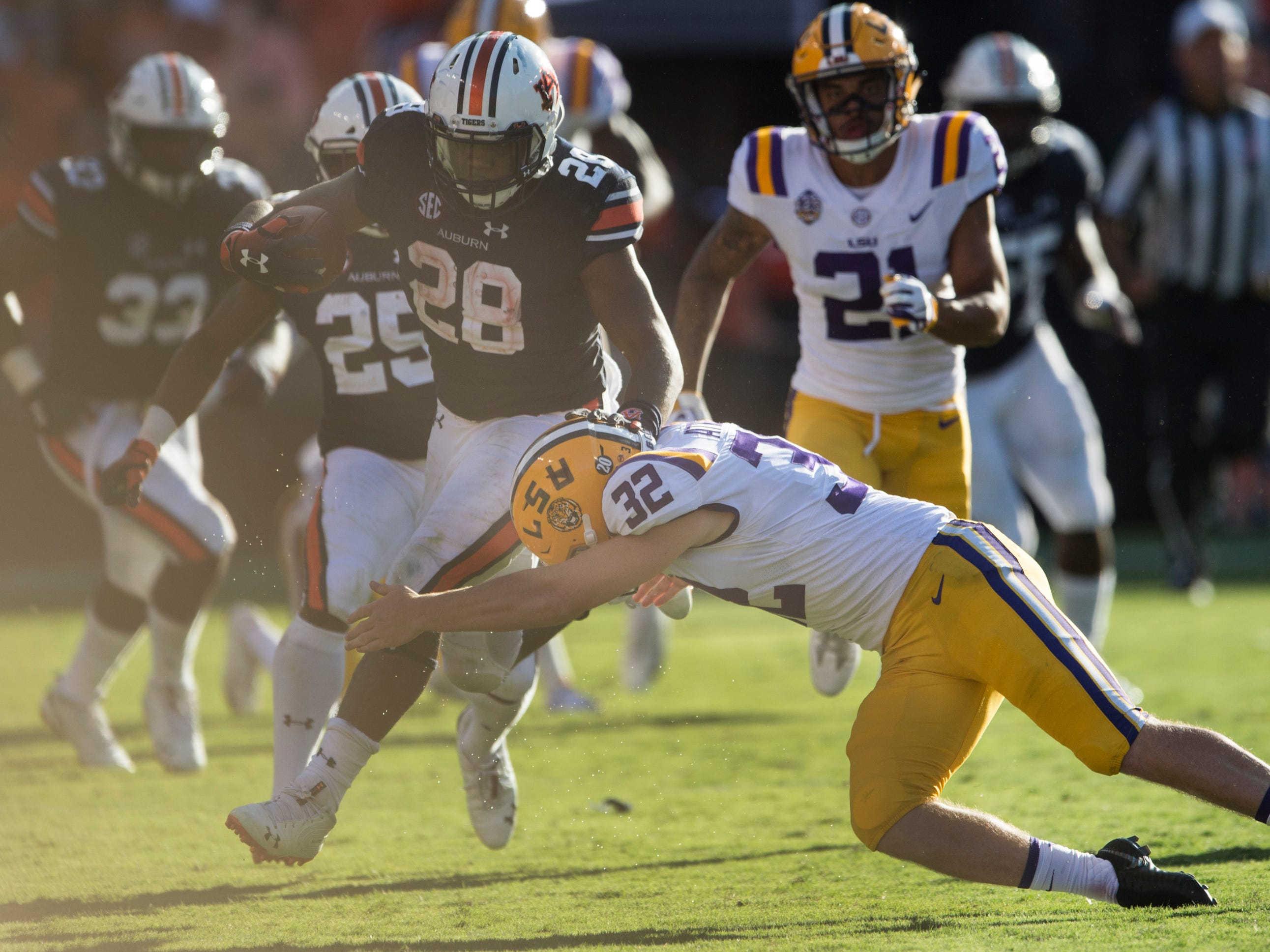 Auburn's JaTarvious Whitlow (28) is pushed out of bounds by Auburn's Sam Sherrod (32) at Jordan-Hare Stadium in Auburn, Ala., on Saturday, Sept. 15, 2018. LSU defeated Auburn 22-21.