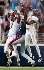Alabama defensive back Trevon Diggs (7) and linebacker Christopher Allen (4) break up a pass in tended for Ole Miss wide receiver D.K. Metcalf (14) In first half action in Oxford, Ms., on Saturday September 15, 2018.