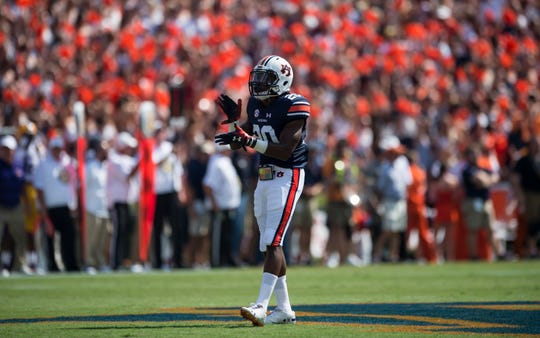 Auburn's Asa Martin (20) pumps up the crowd during the opening kickoff at Jordan-Hare Stadium in Auburn, Ala., on Saturday, Sept. 15, 2018. LSU defeated Auburn 22-21.