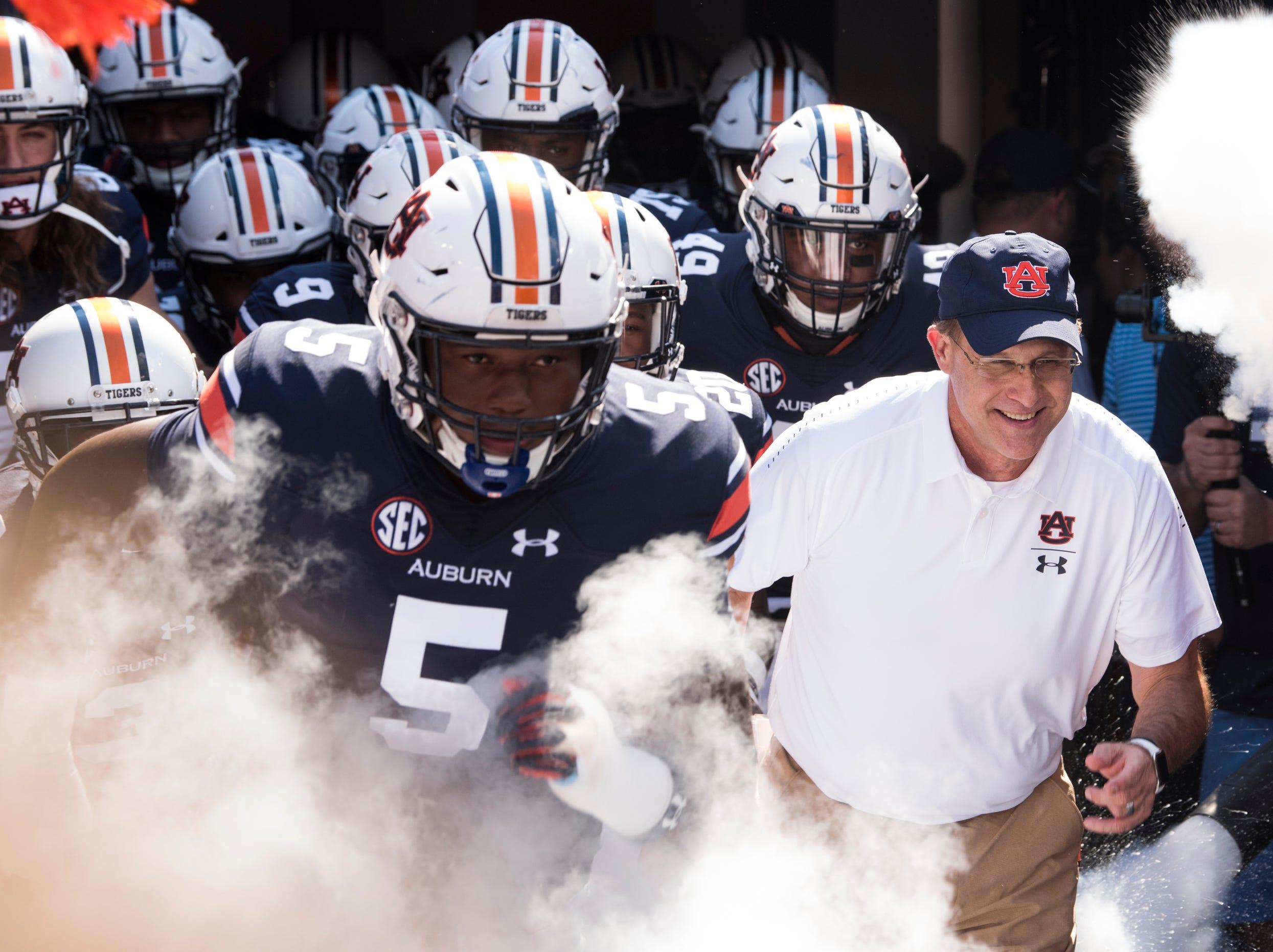 Auburn head coach Gus Malzahn leads his team out before taking on LSU at Jordan-Hare Stadium in Auburn, Ala., on Saturday, Sept. 15, 2018. LSU defeated Auburn 22-21.