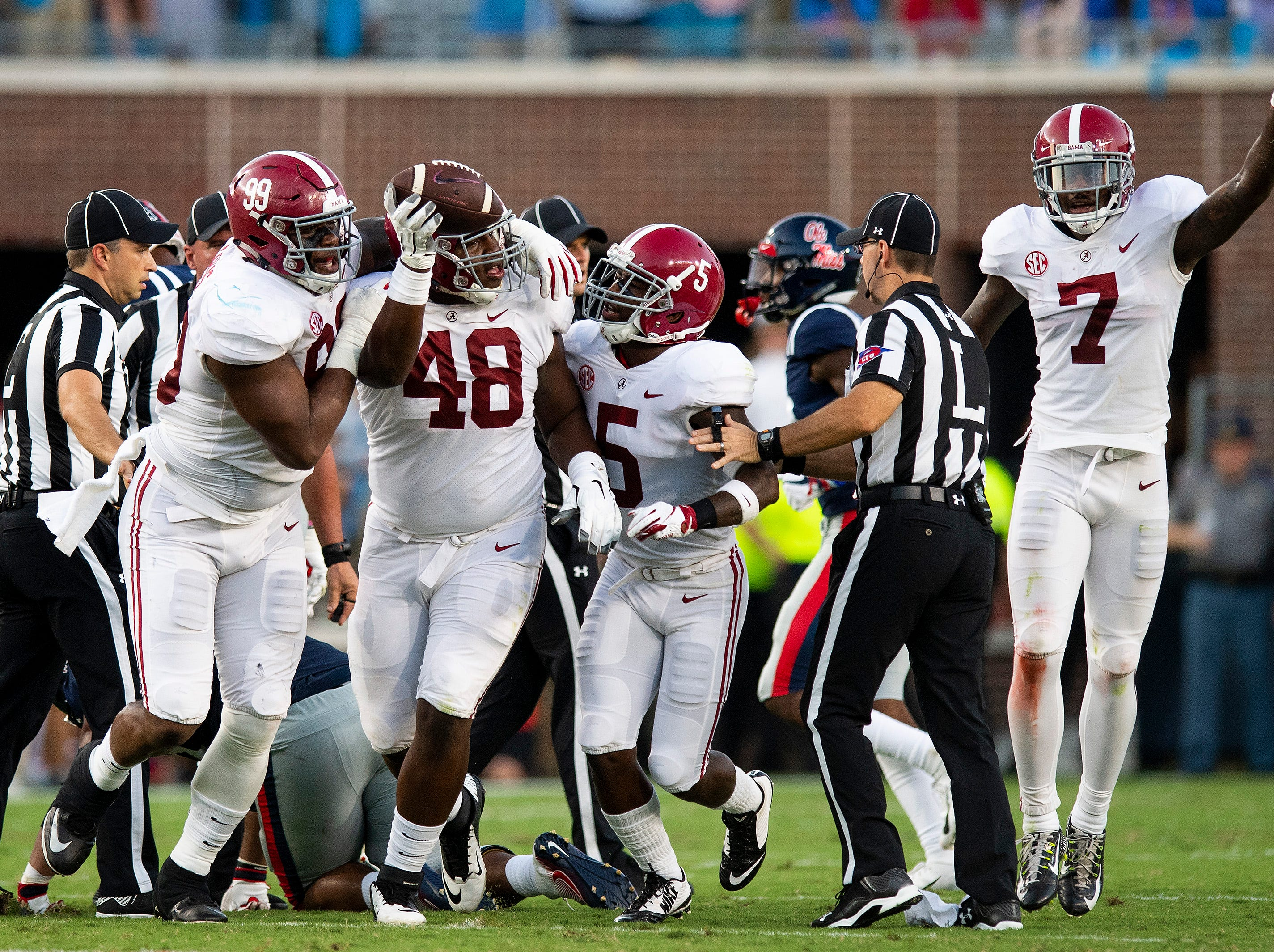 Alabama defensive lineman Phidarian Mathis (48) recovered an Ole Miss fumble In first half action in Oxford, Ms., on Saturday September 15, 2018.