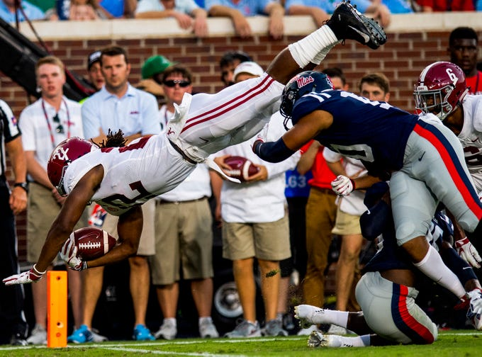 Alabama running back Najee Harris (22) dives in for a touchdown against Ole Miss in first half action in Oxford, Ms., on Saturday September 15, 2018.