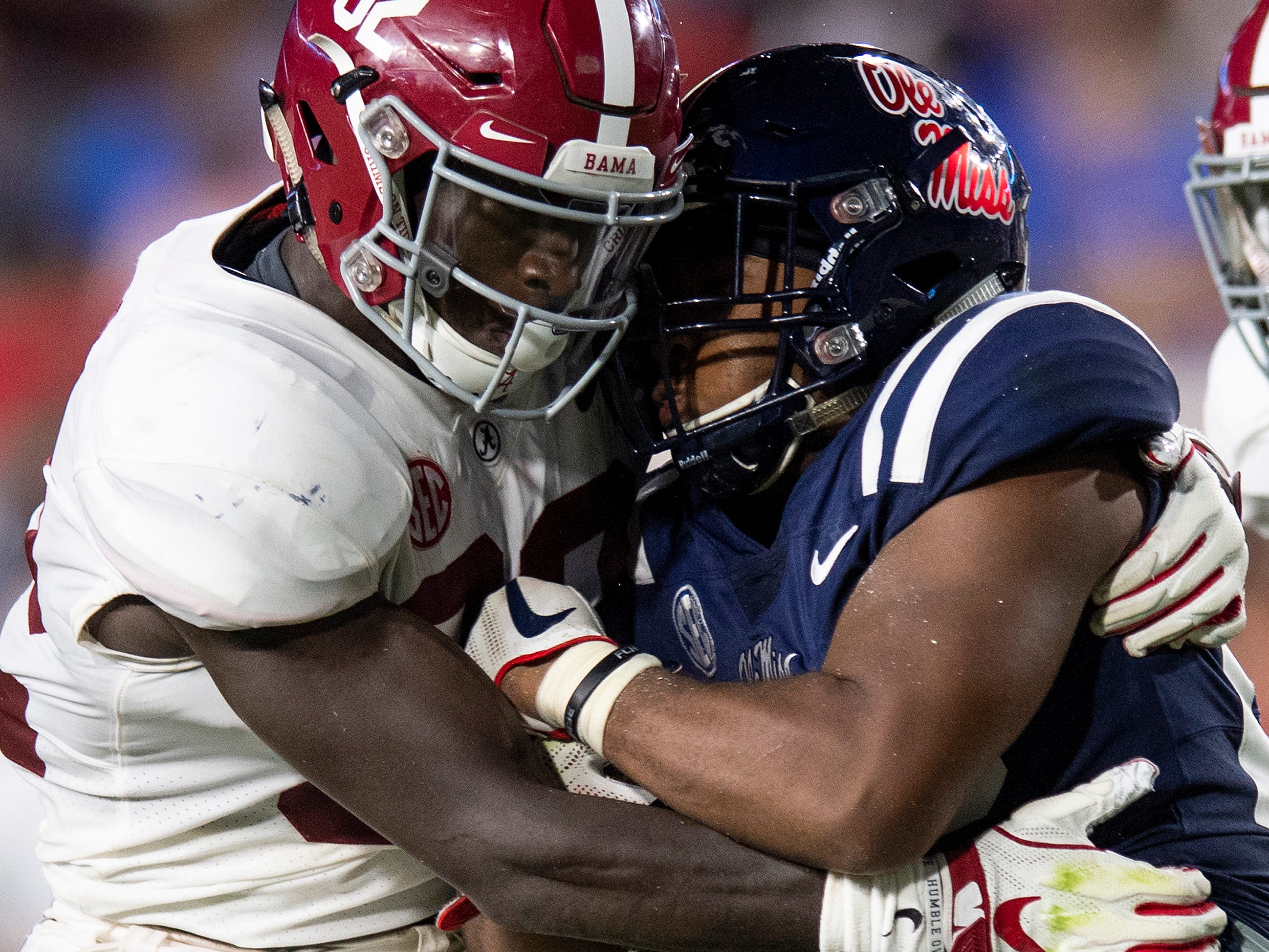 Alabama linebacker Dylan Moses (32) stops Ole Miss running back Scottie Phillips (22) In first half action in Oxford, Ms., on Saturday September 15, 2018.